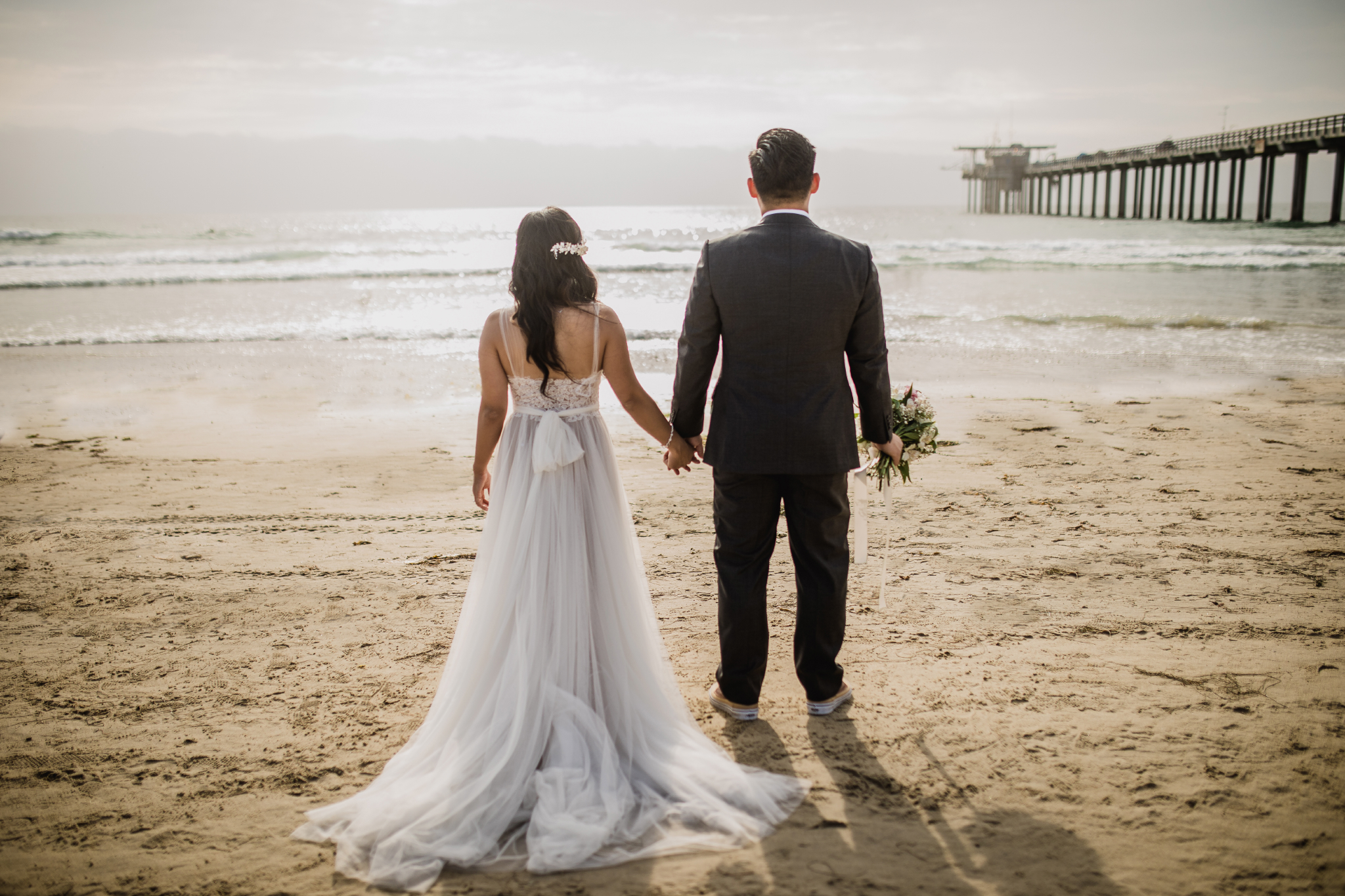 san diego wedding   photographer | couple holding hands looking at beach