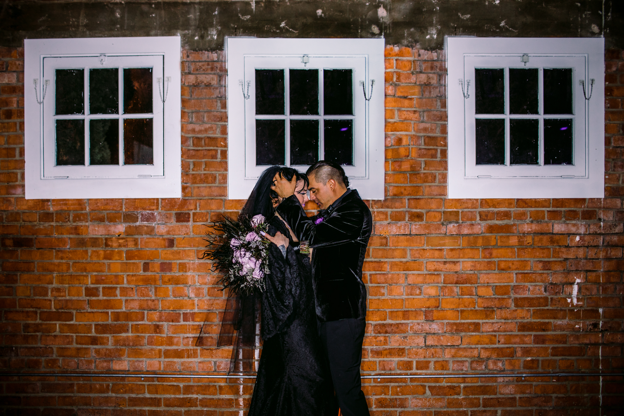 san diego wedding   photographer | couple about to kiss in front of brick wall