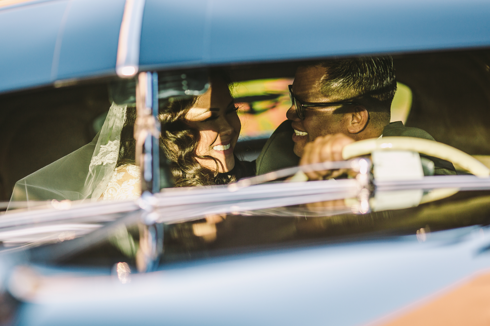 san diego wedding   photographer | couple smiling at each other in car