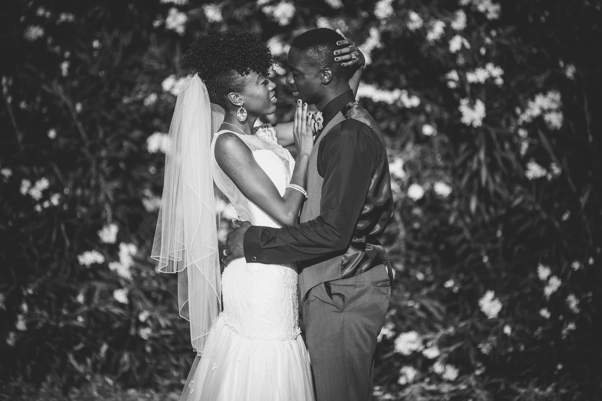 san diego wedding   photographer | couple holding each other in front of flowers