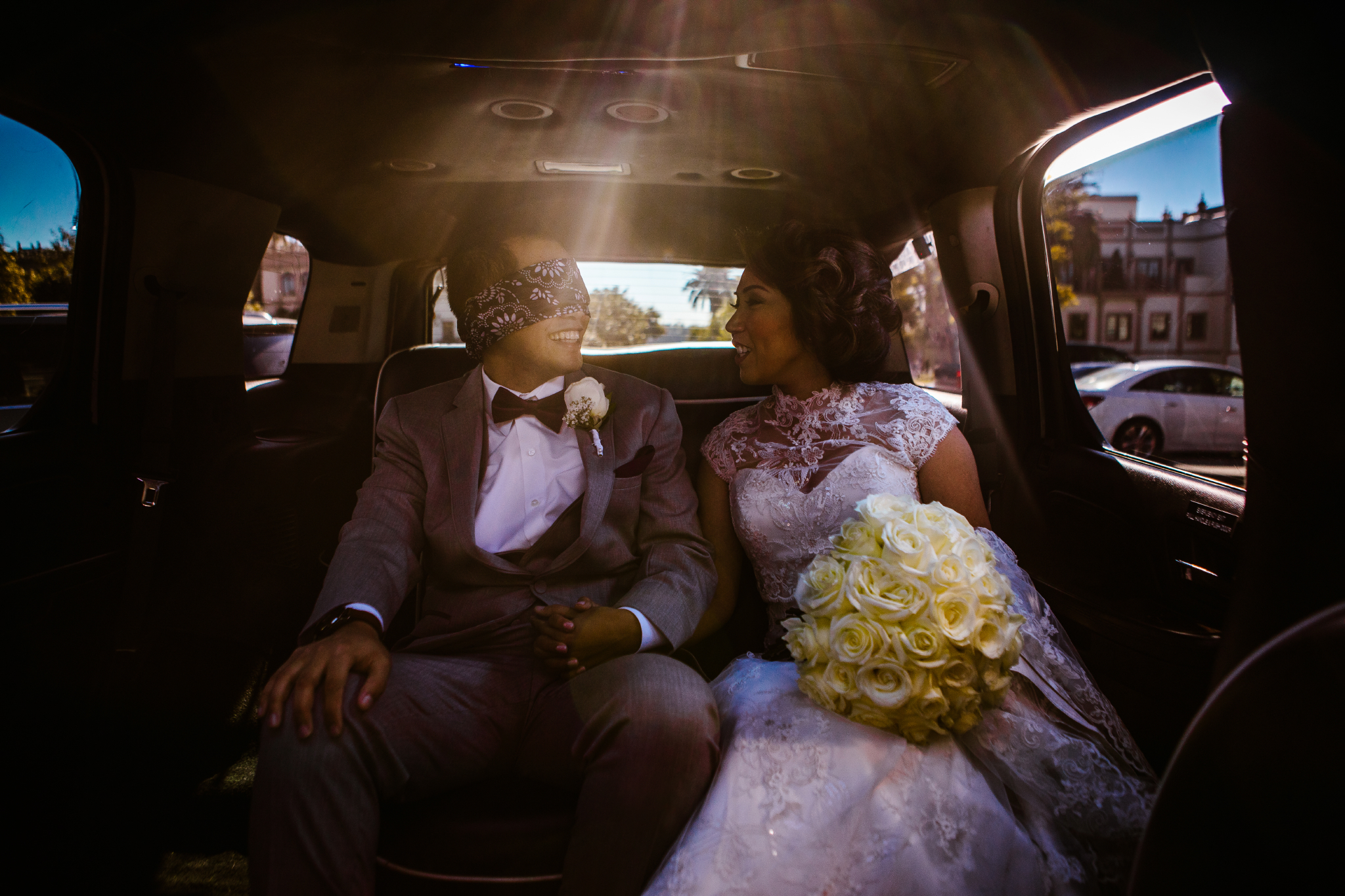 san diego wedding   photographer | man in blindfold with woman in car