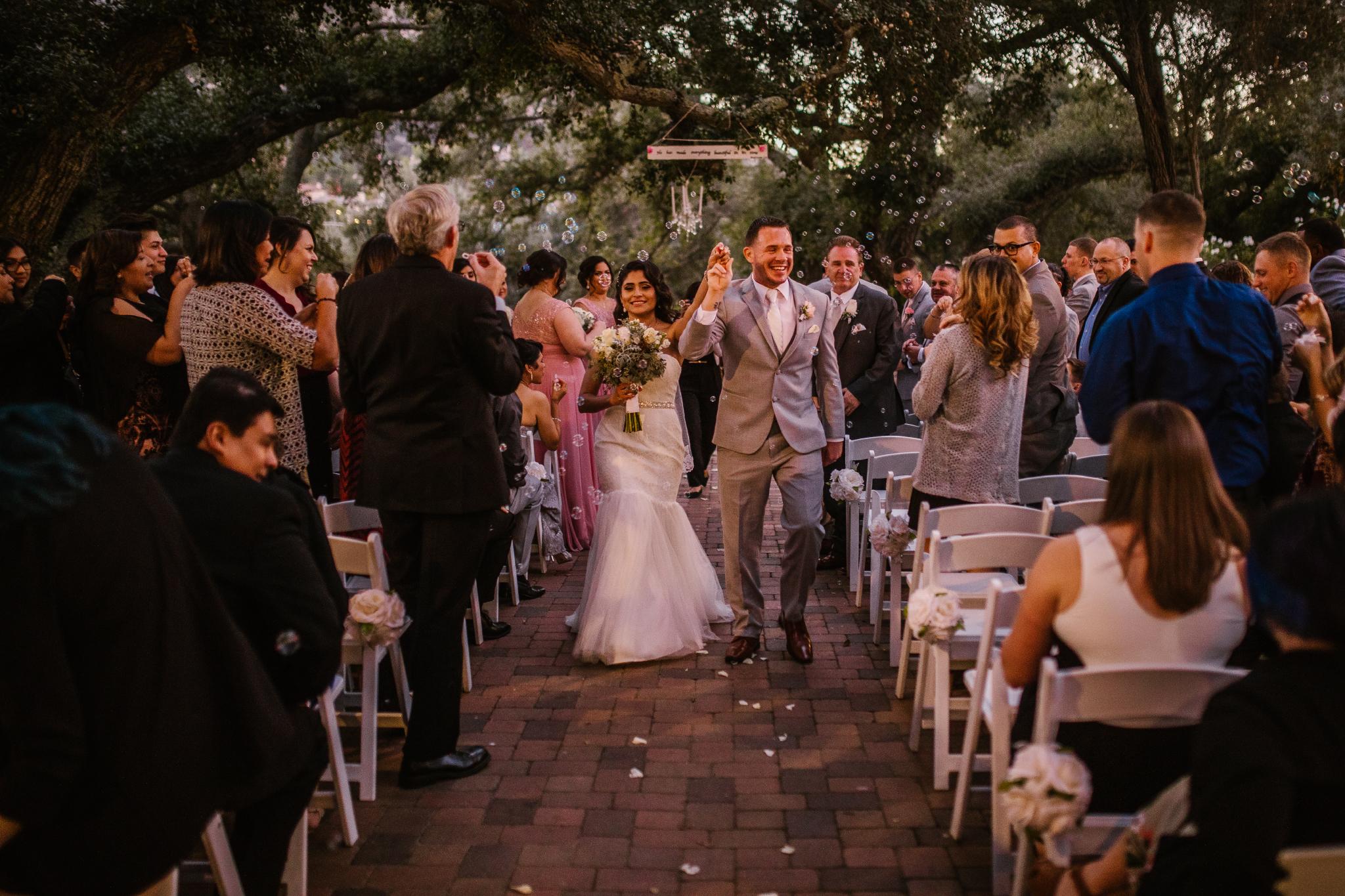 san diego wedding   photographer | couple walking up an aisle