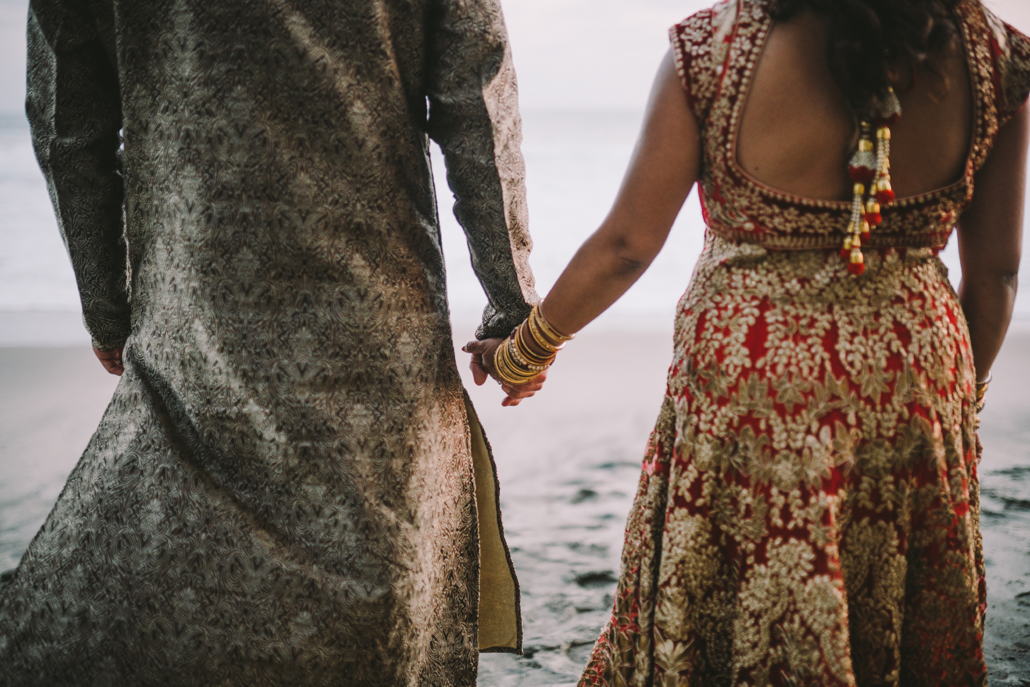san diego wedding   photographer | couple holding hands in traditional clothing