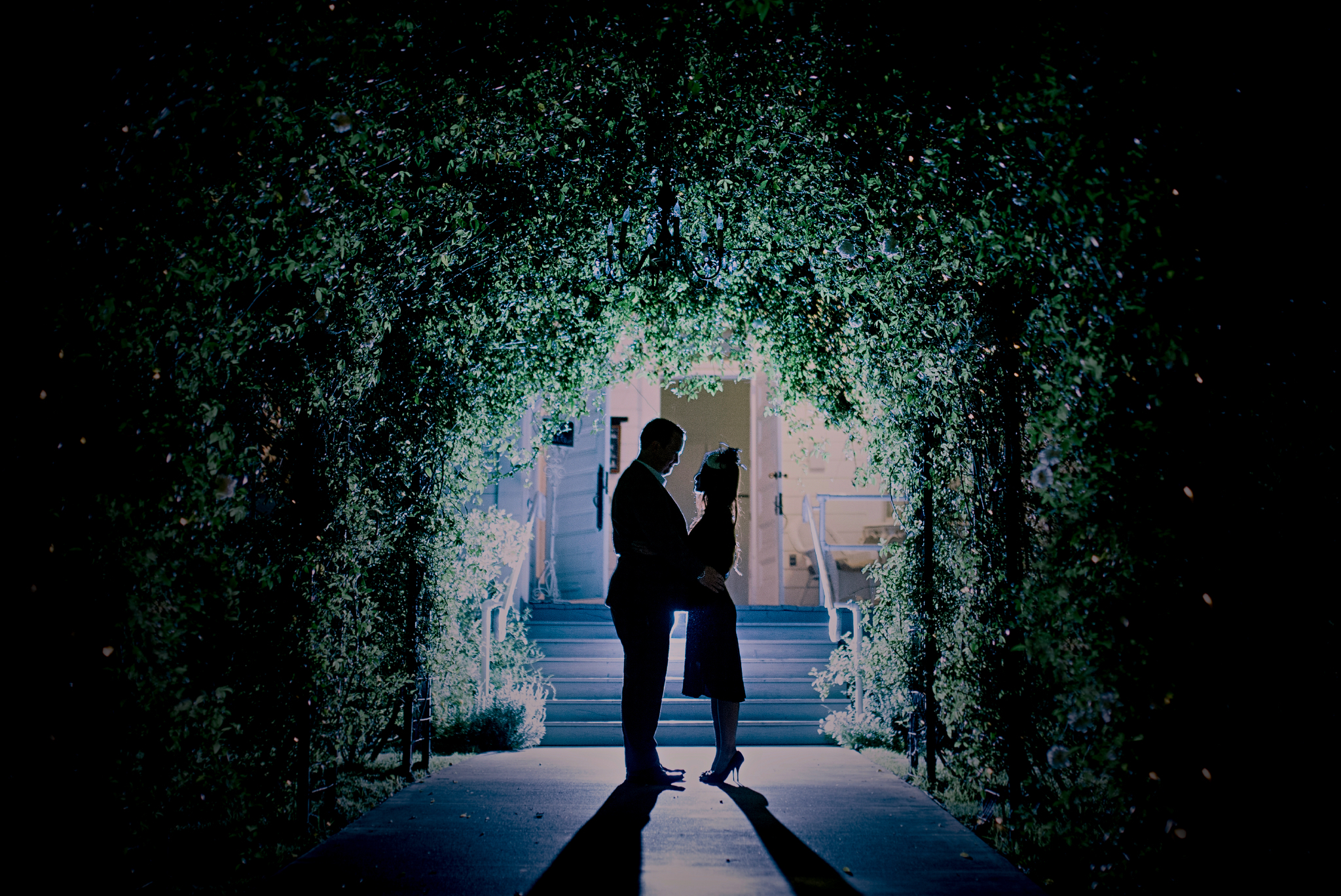 san diego wedding   photographer | couple looking at each other in tunnel of plants