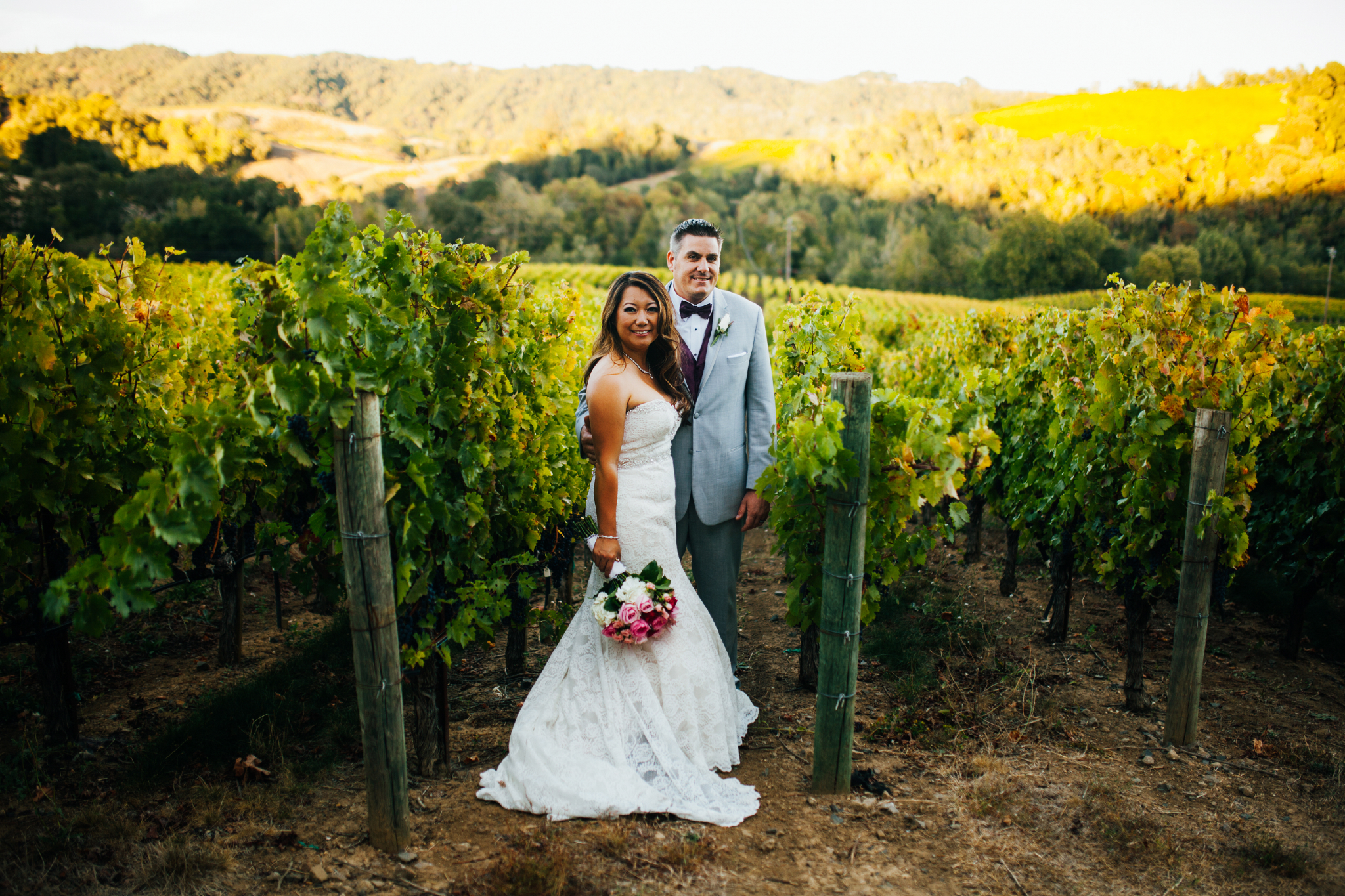 san diego wedding   photographer | couple with bouquet of flowers in plantation