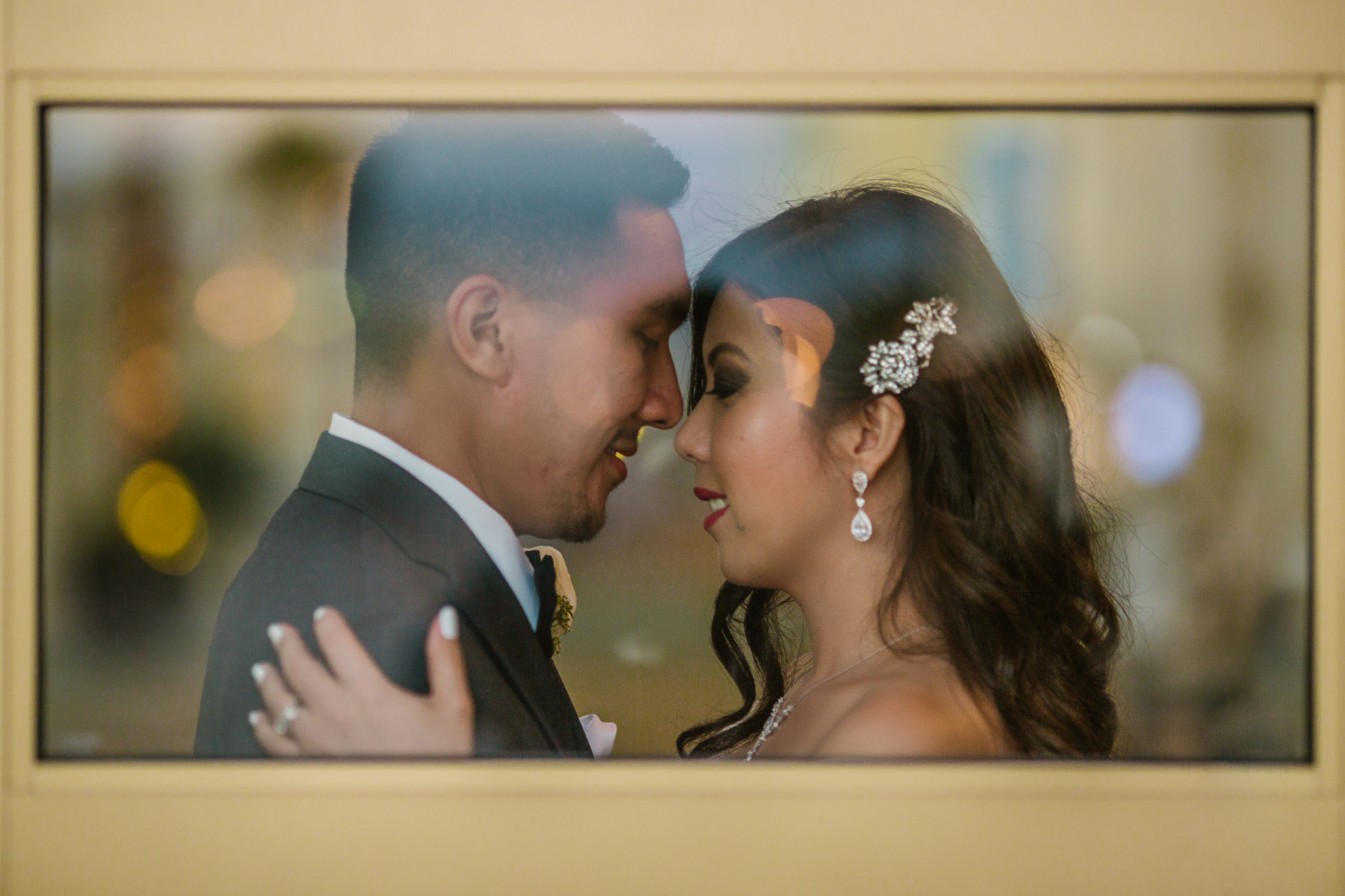 san diego wedding   photographer | couple looking at each other behind glass window