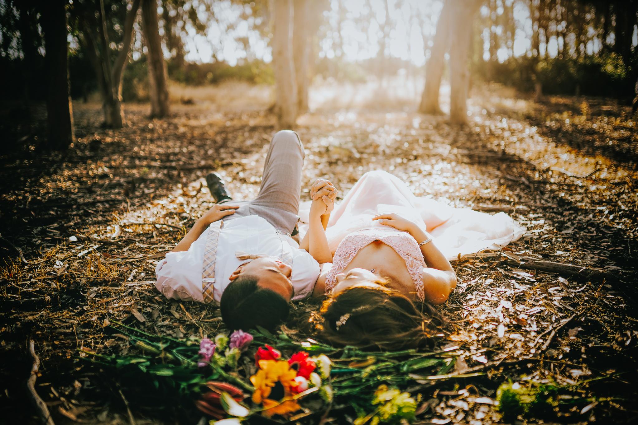 san diego wedding   photographer | couple lying on the ground