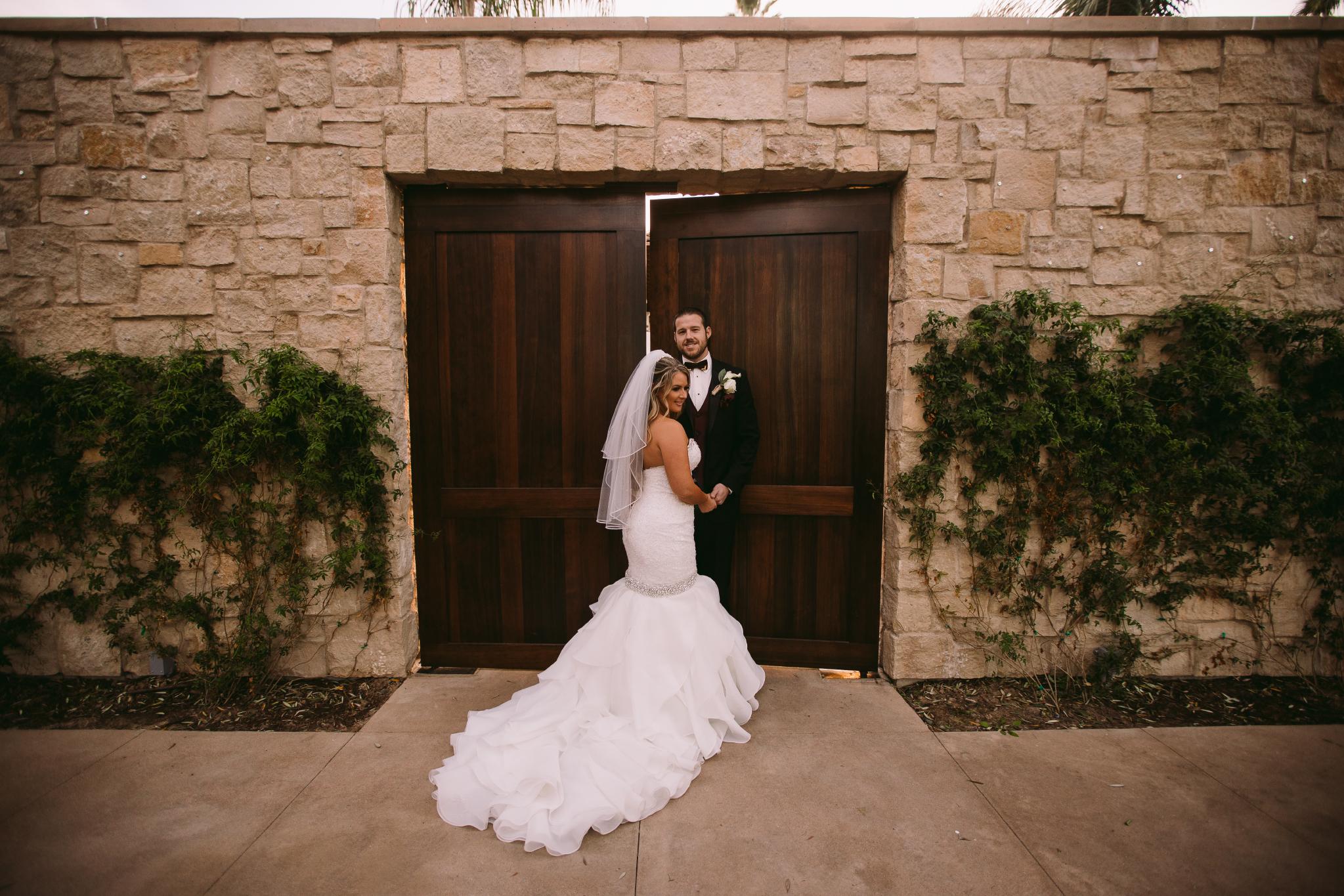 san diego wedding   photographer | couple standing in fron of ajar door
