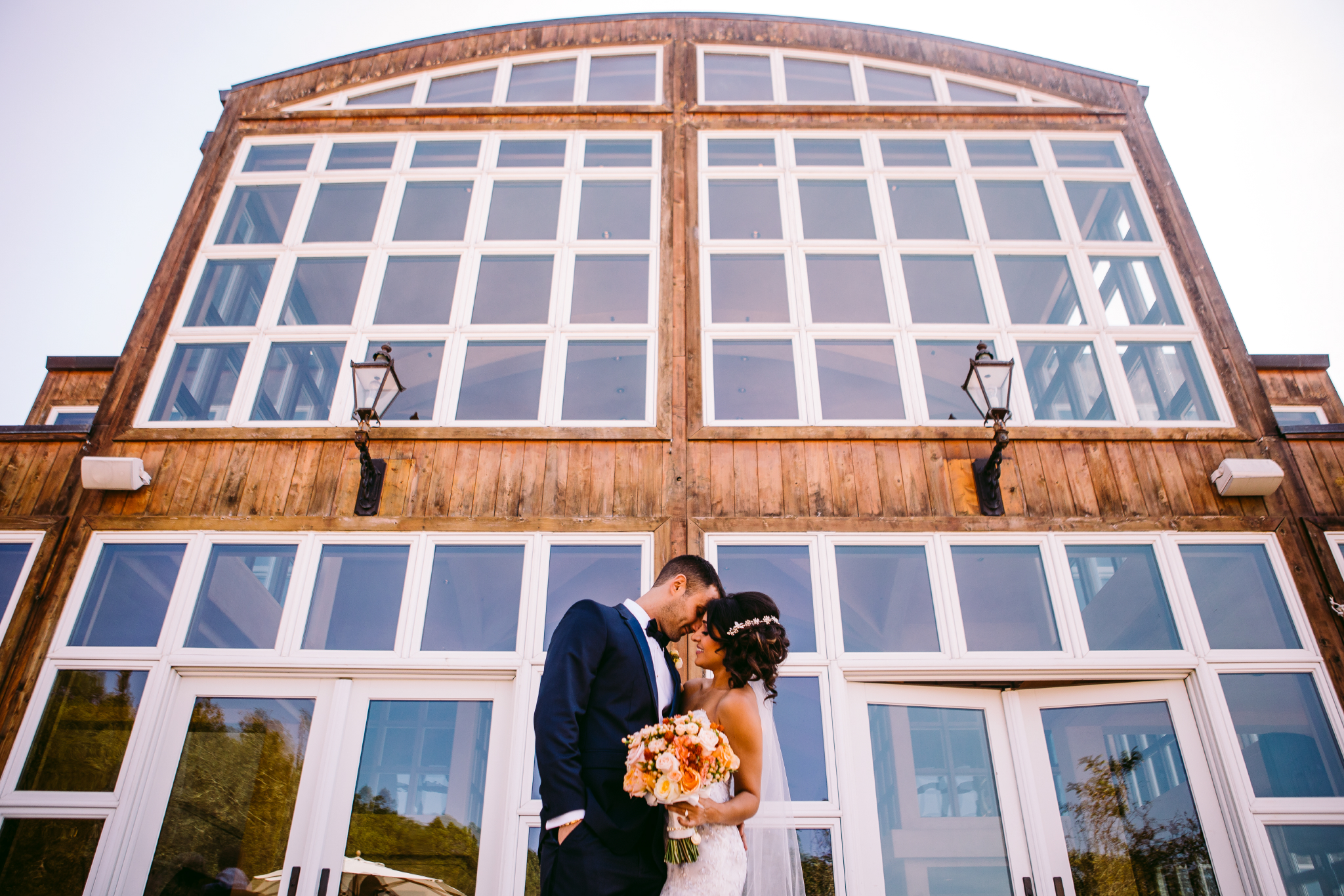 san diego wedding photographer | couple in front of windows