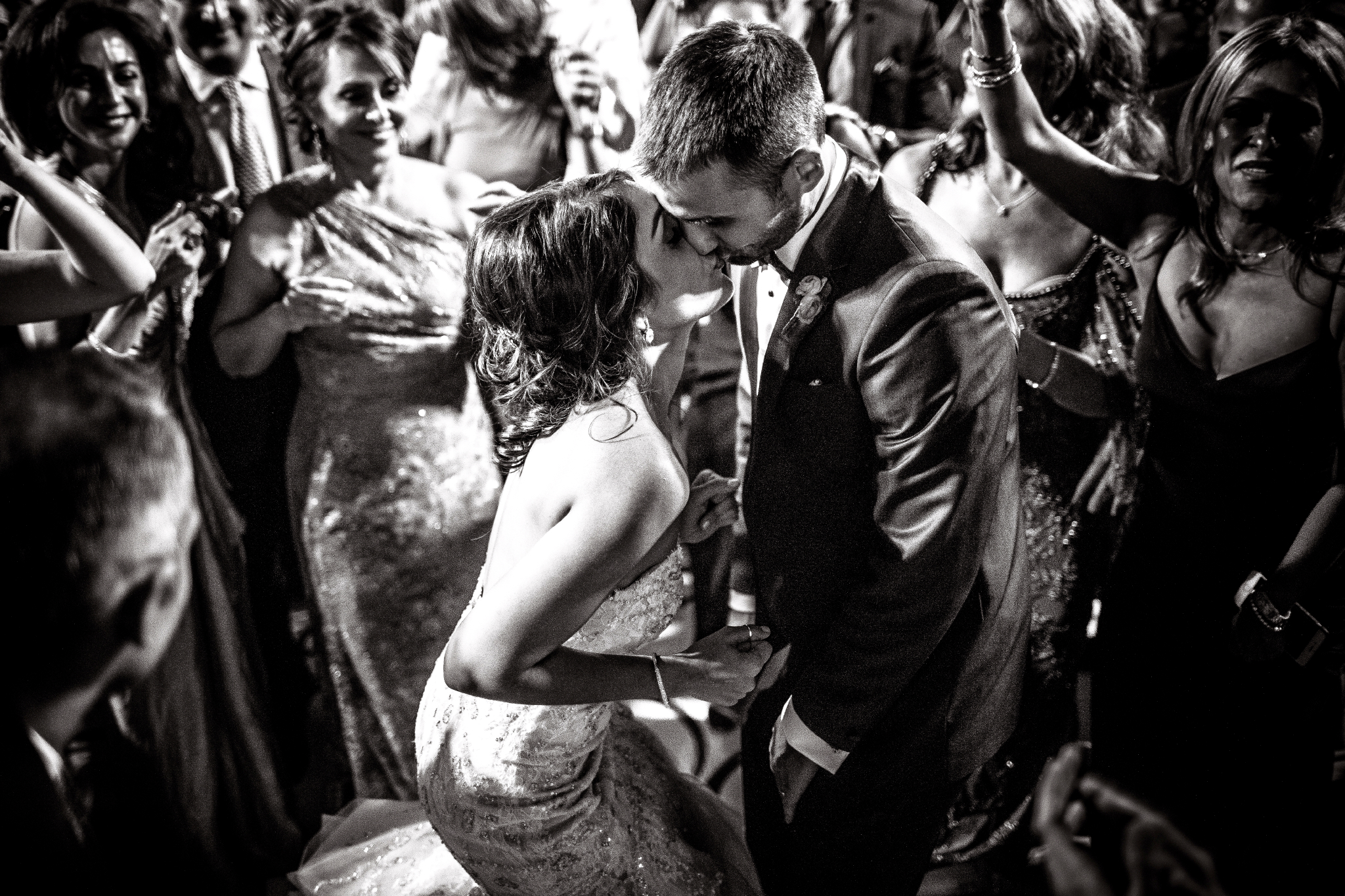 san diego wedding   photographer | couple kissing in front of crowd