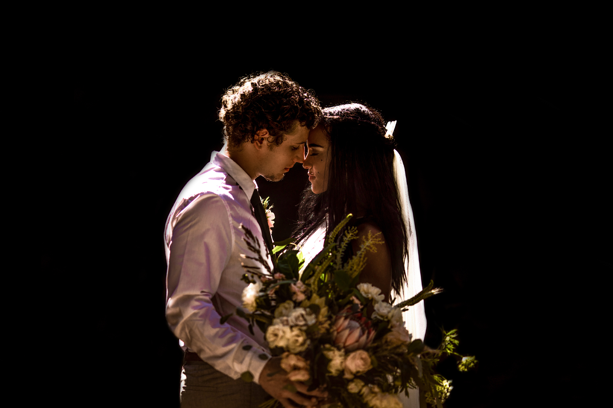 san diego wedding   photographer | couple with flowers about to kiss