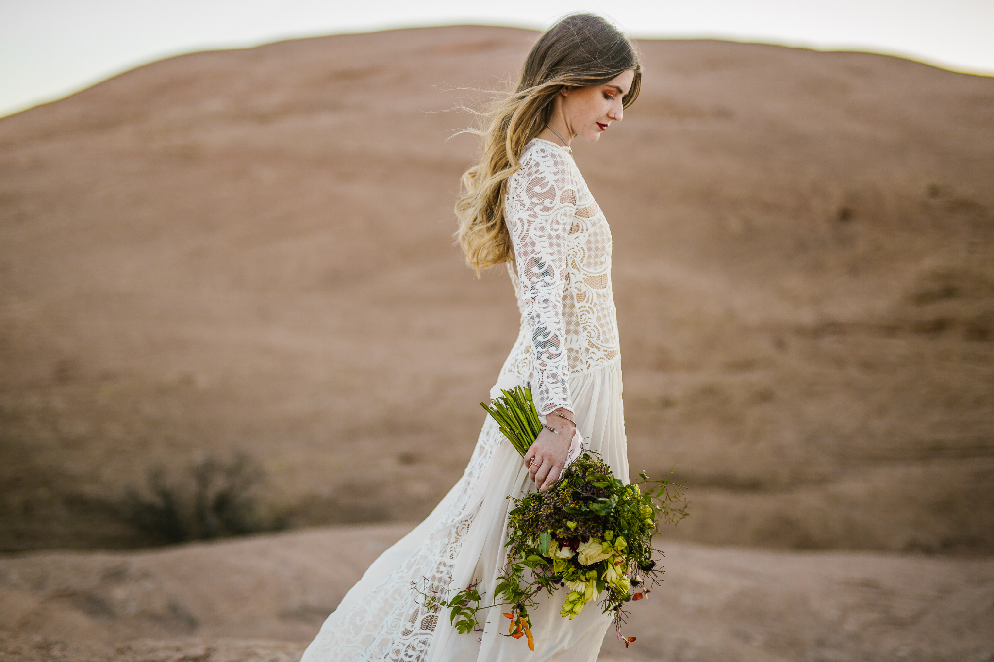 san diego wedding   photographer | woman holding flowers on hill