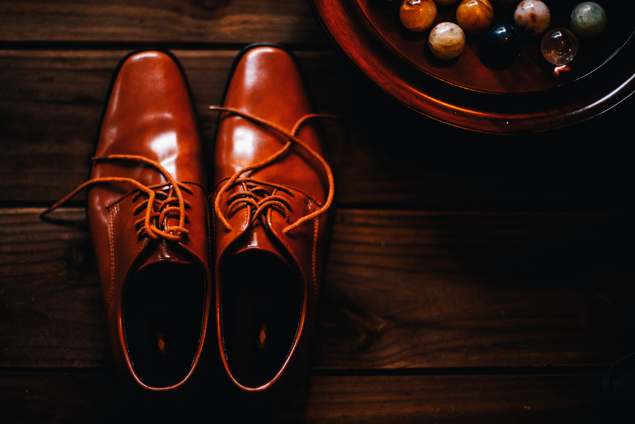san diego wedding   photographer | picture of man's oxford shoes with marbles beside them