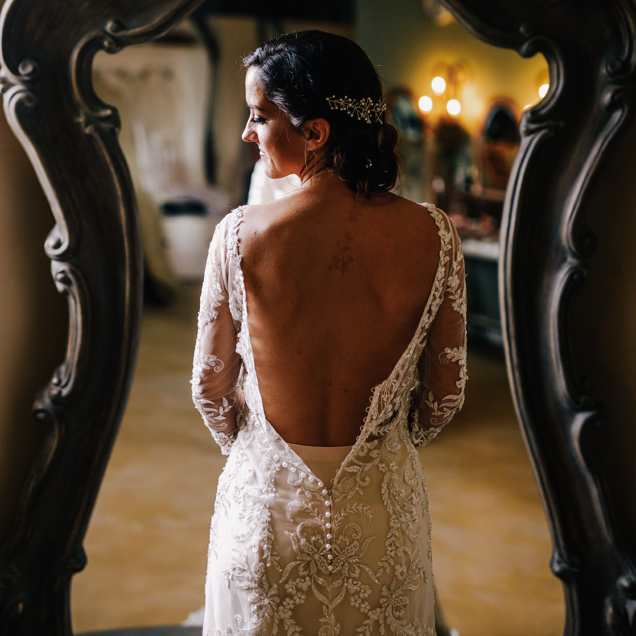 san diego wedding   photographer | woman from behind wearing unzipped wedding dress looking back