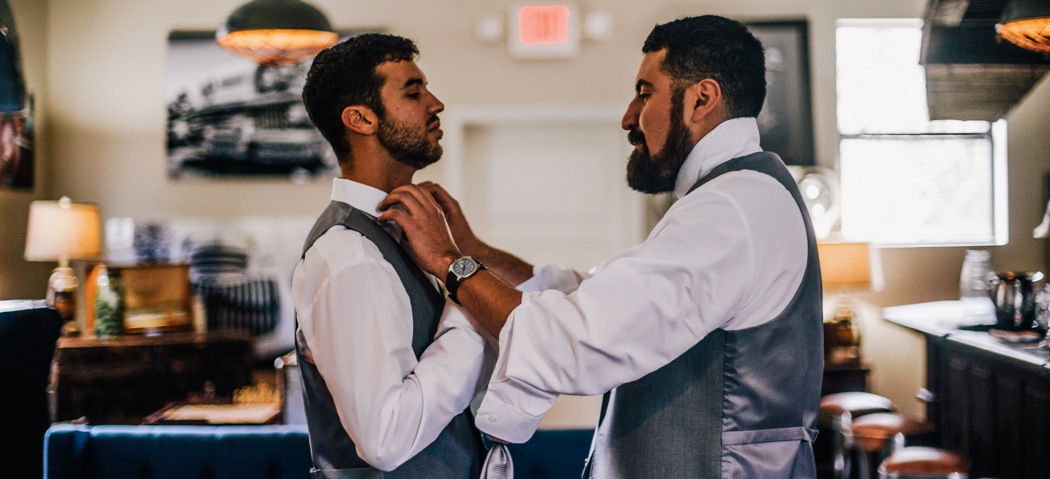 san diego wedding   photographer | 2 men with grey vests helping each other fix up