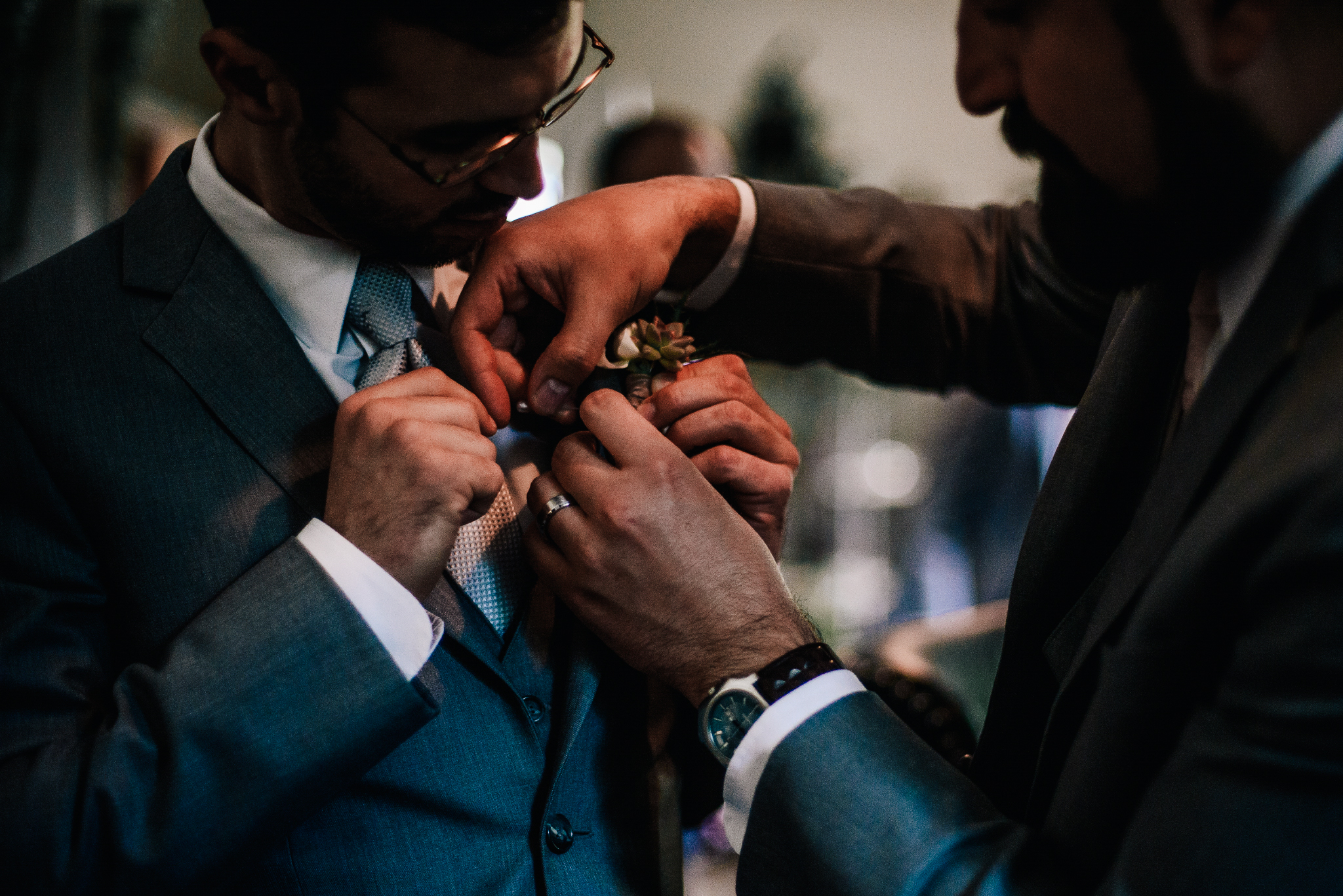 san diego wedding   photographer | men in grey suits helping each other put on boutonniere