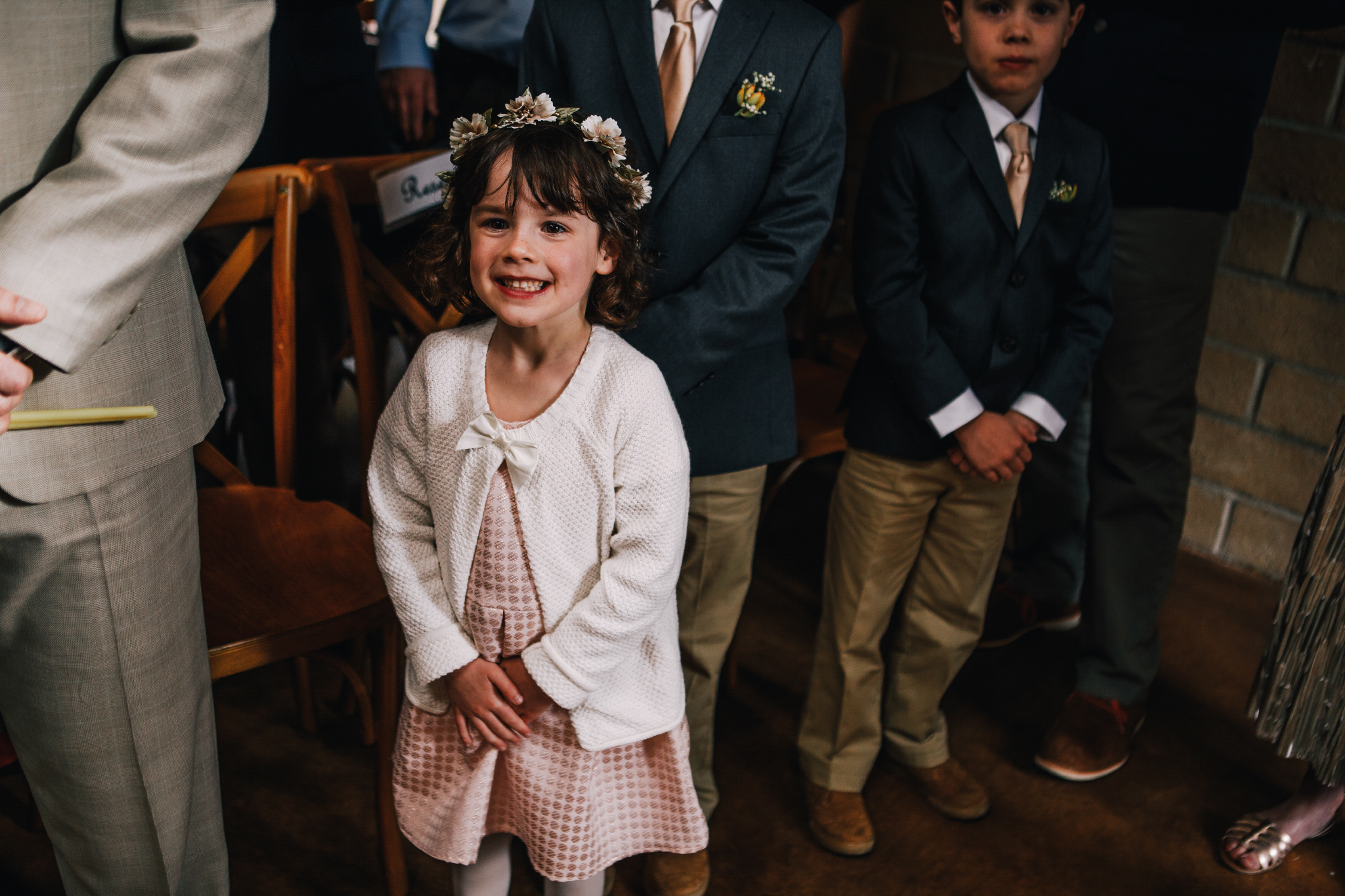 san diego wedding   photographer | child with flower crown smiling in crowd