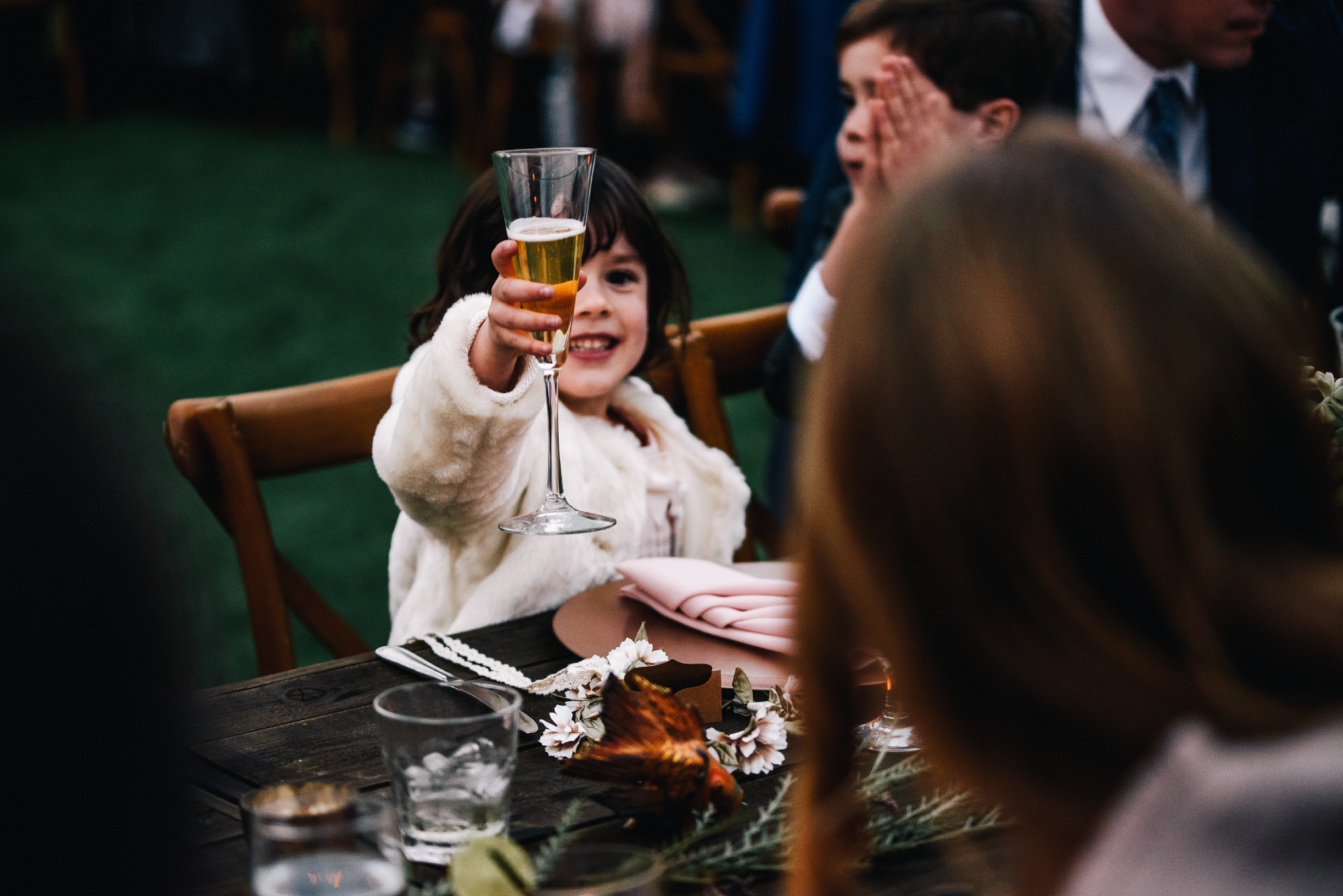 san diego wedding   photographer | child raising a glass on dinner table