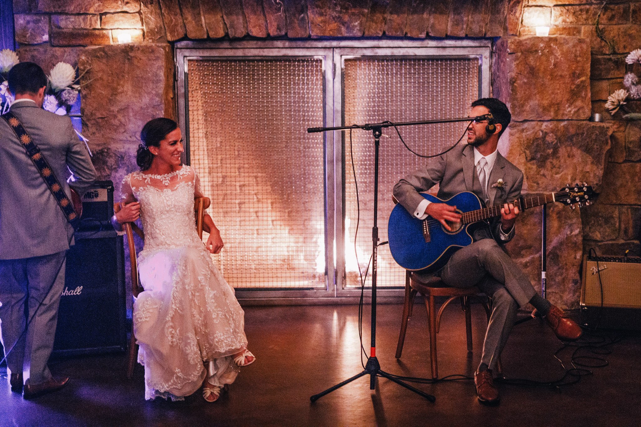 san diego wedding   photographer | groom playing a guitar with the bride seated beside him