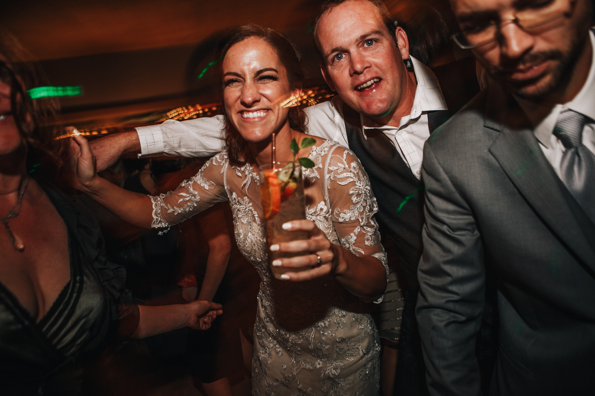 san diego wedding   photographer | bride holding a drink in the middle of a crowd