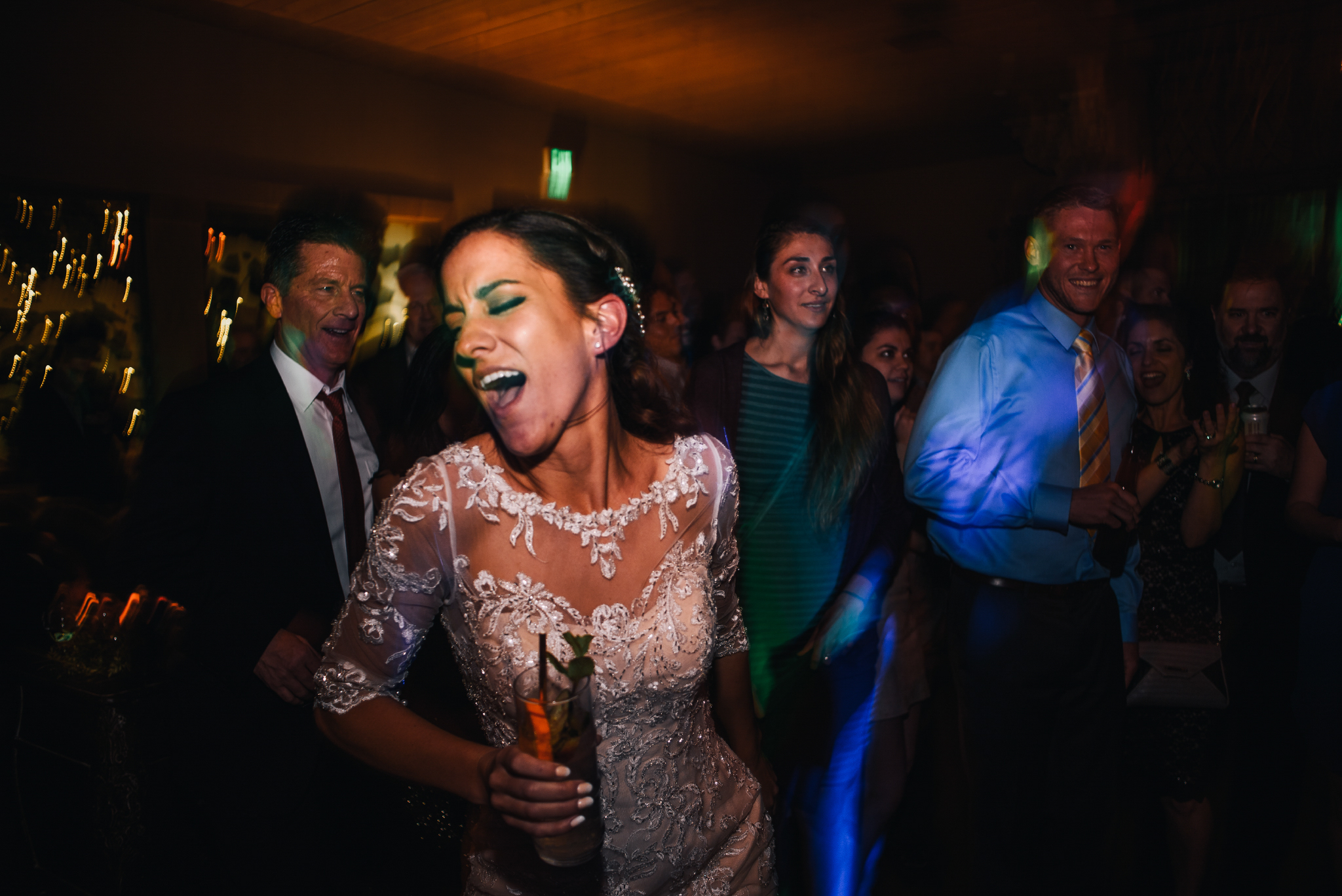 san diego wedding   photographer | bride dancing on dance floor with a drink in her hand