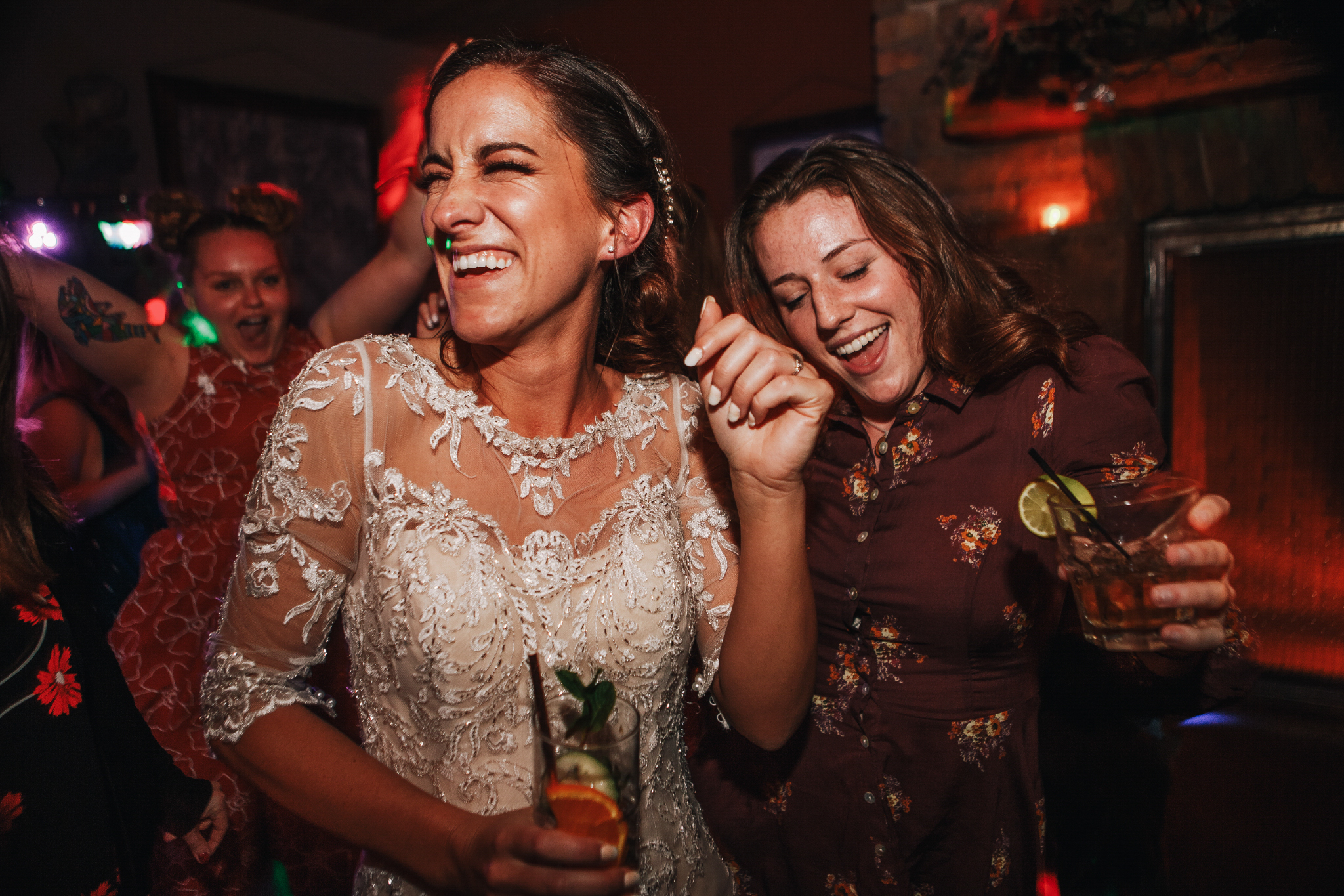 san diego wedding   photographer | bride dancing with a woman in a burgundy dress holding a drink
