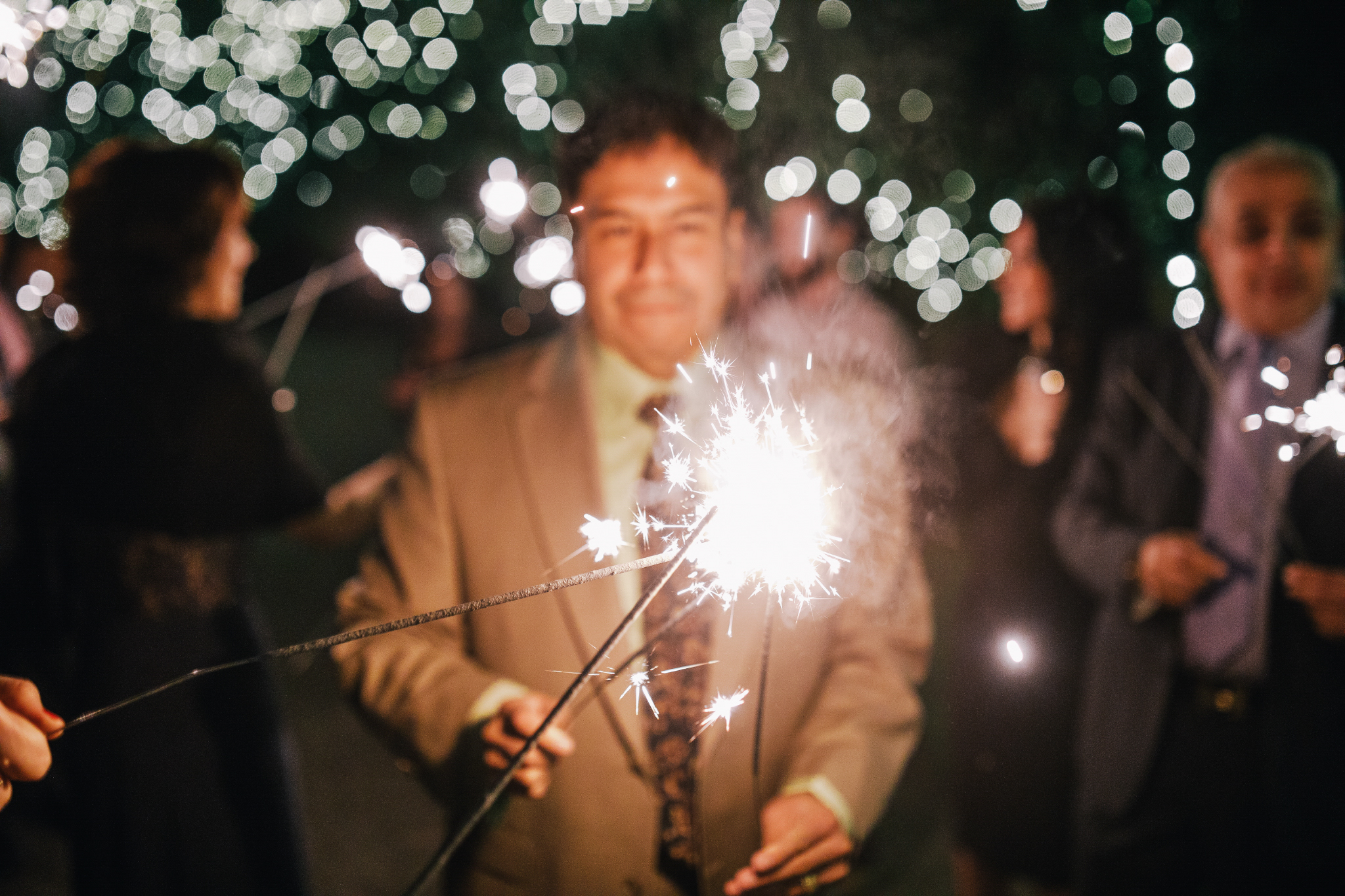 san diego wedding   photographer | sparklers lit with a crowd in background