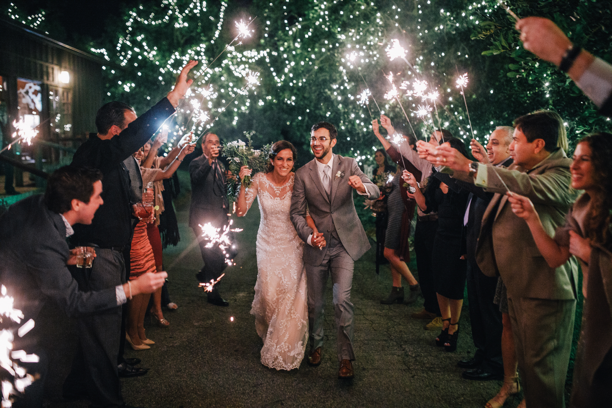 san diego wedding   photographer | married couple walking under sparklers held by crowd
