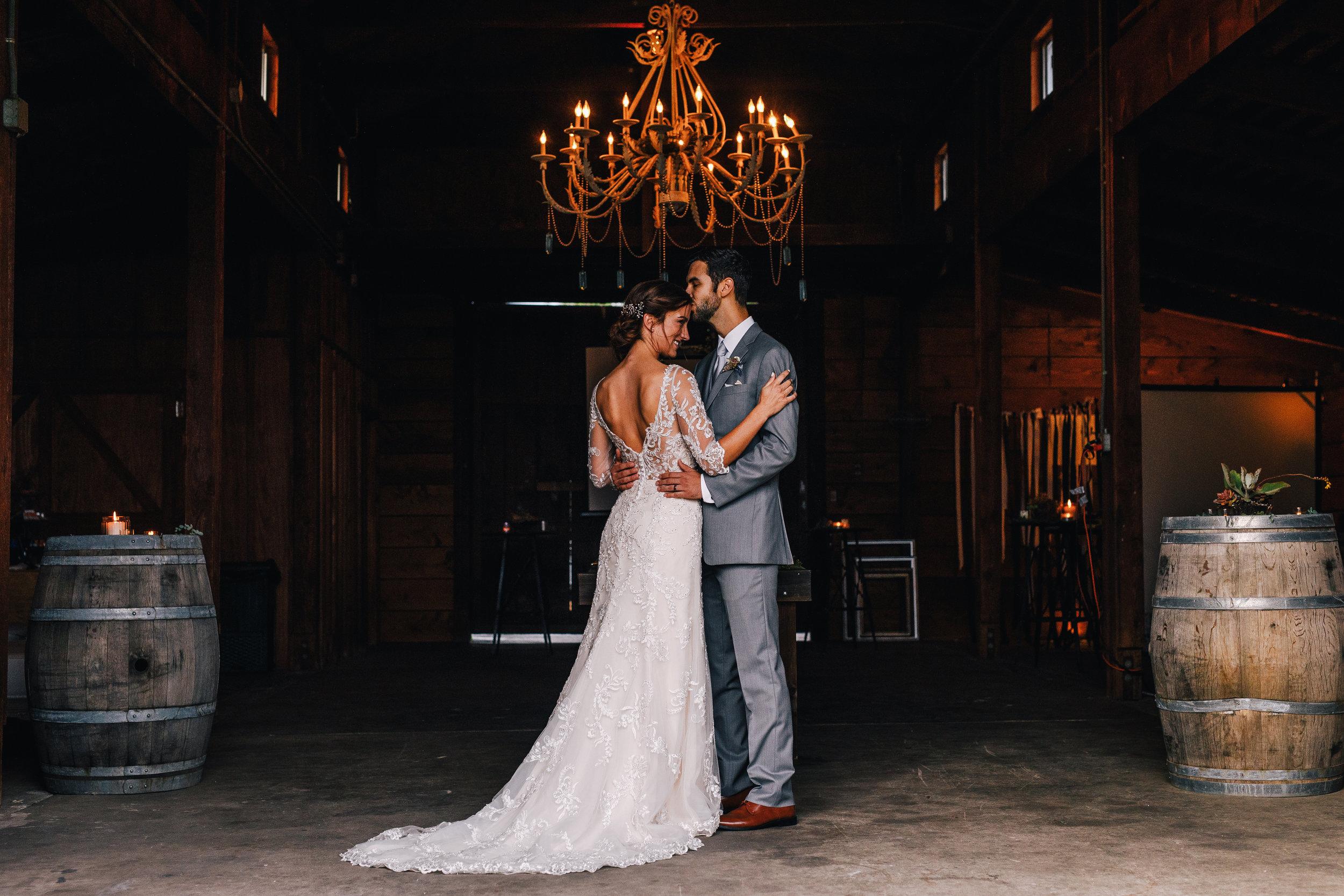 san diego wedding   photographer | couple under chandelier