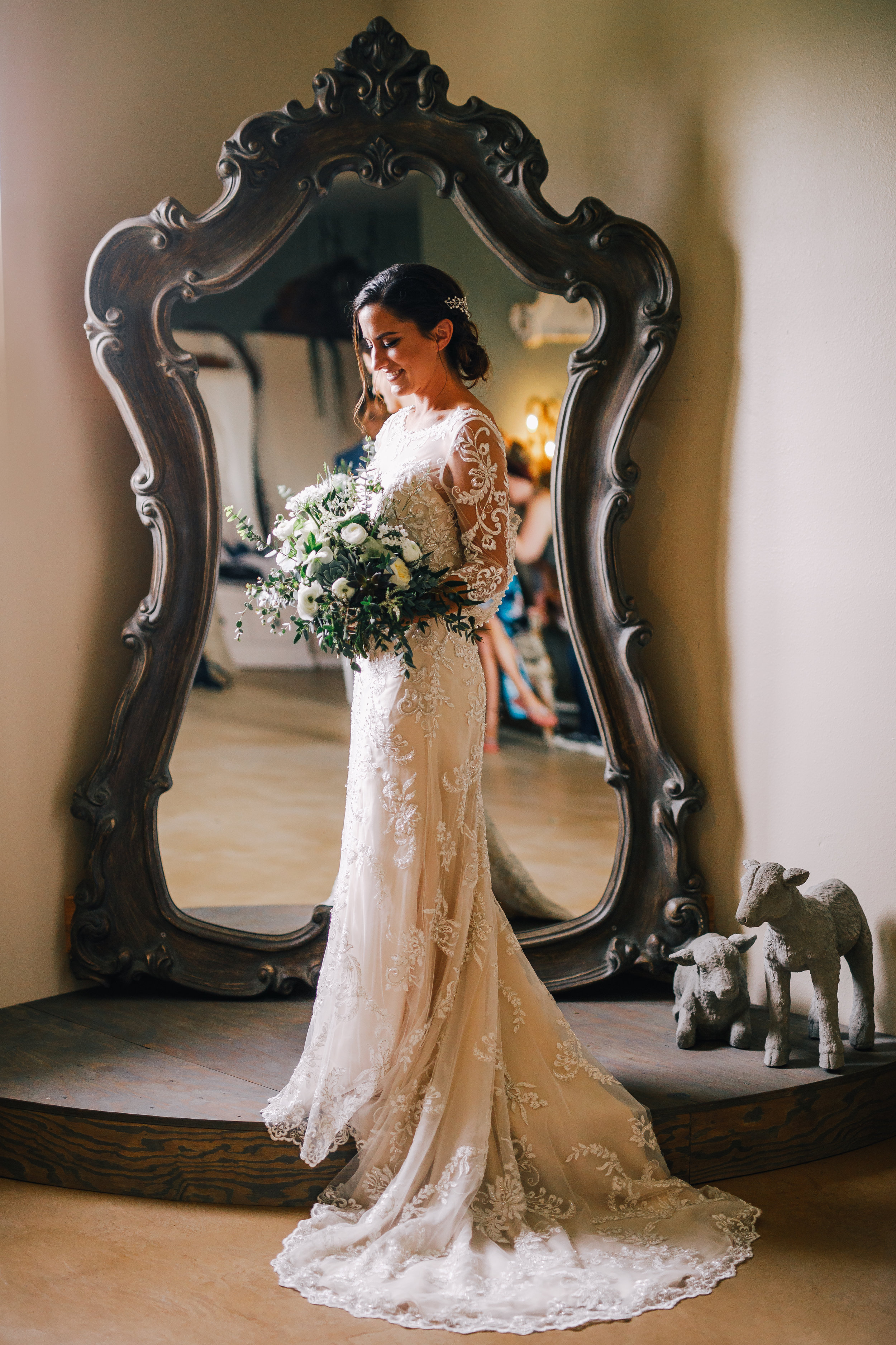 san diego wedding   photographer | woman holding flowers in front of mirror