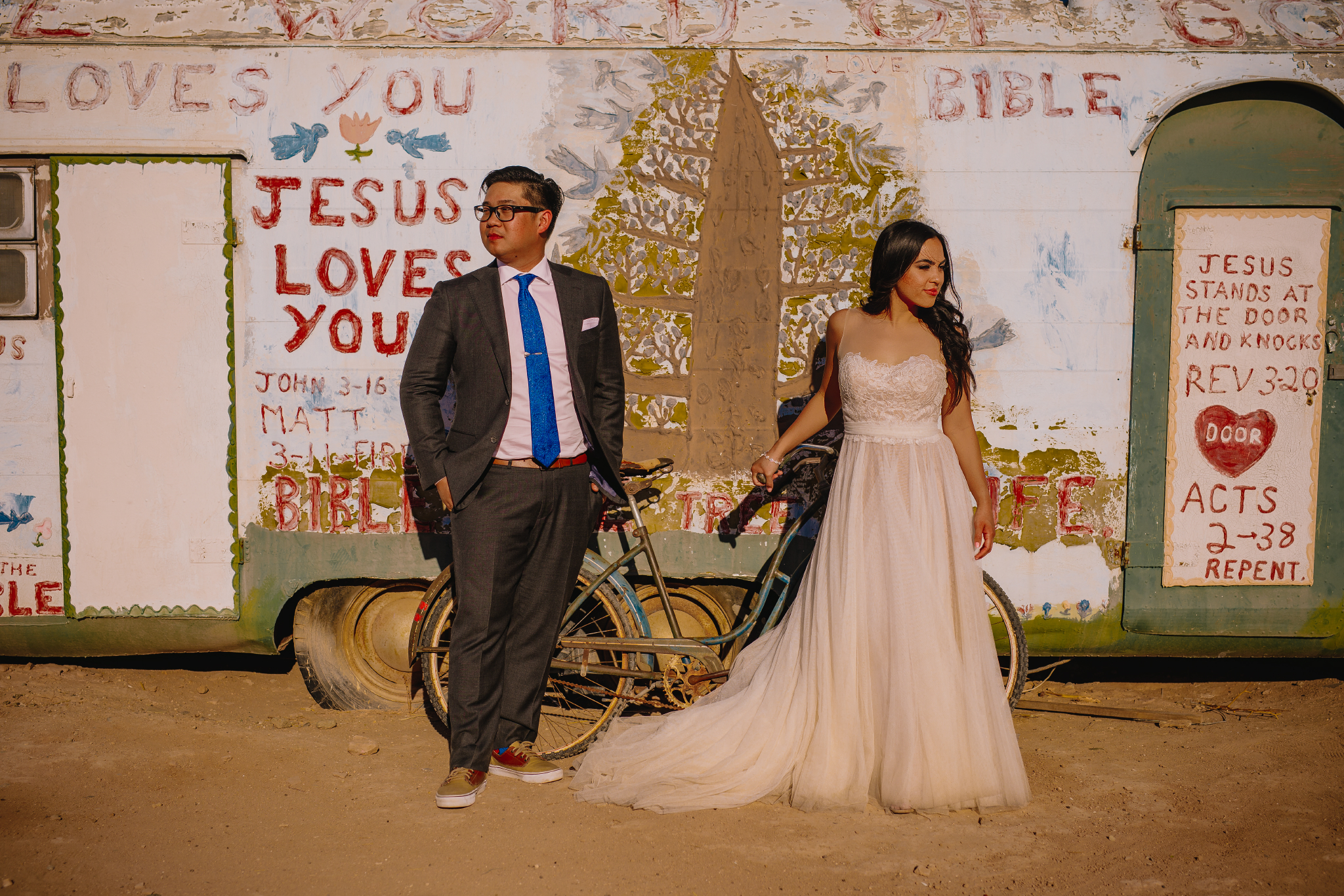 san diego wedding   photographer | couple looking away in front of bikes