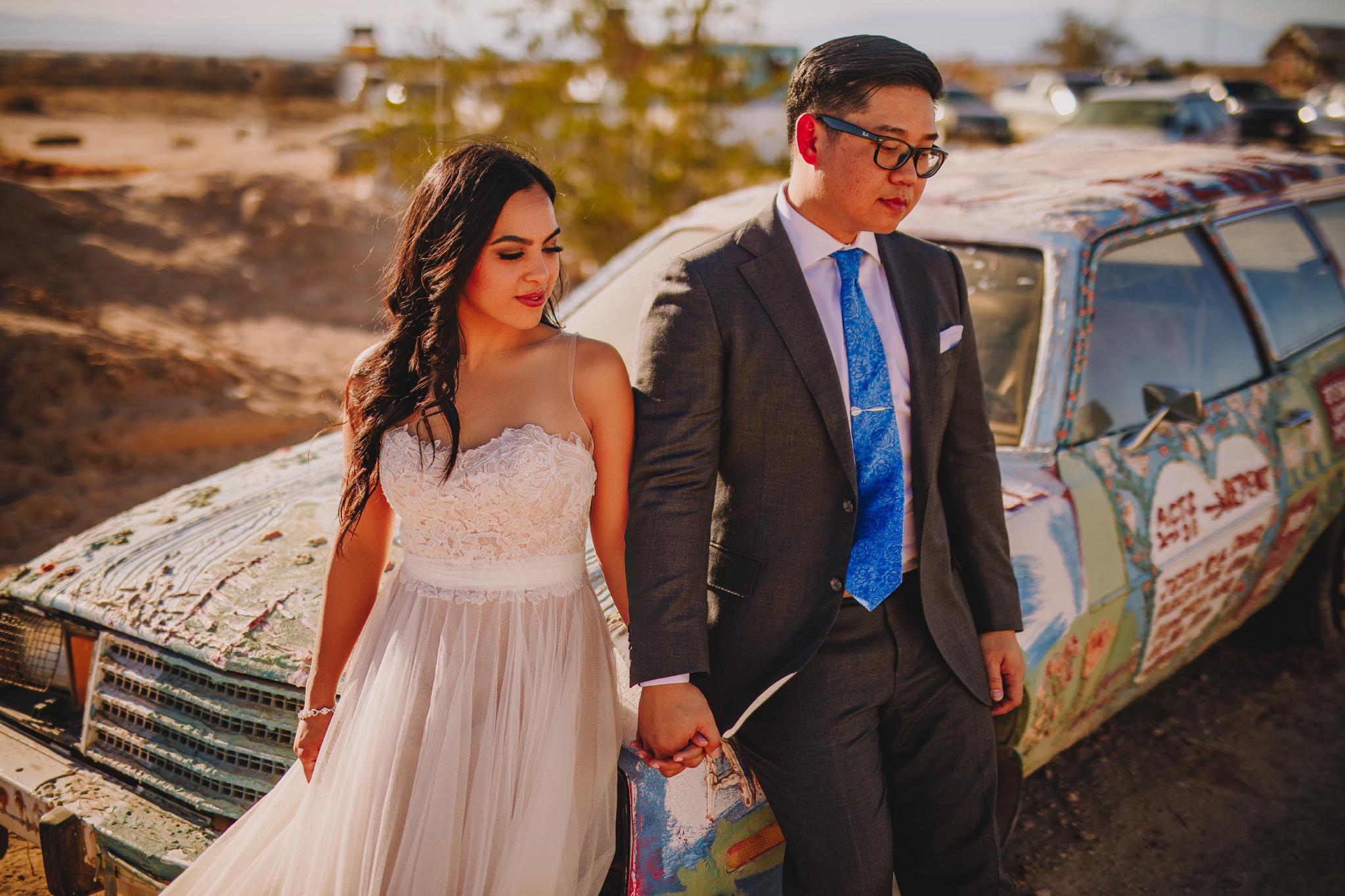 san diego wedding   photographer | couple holding hands on car