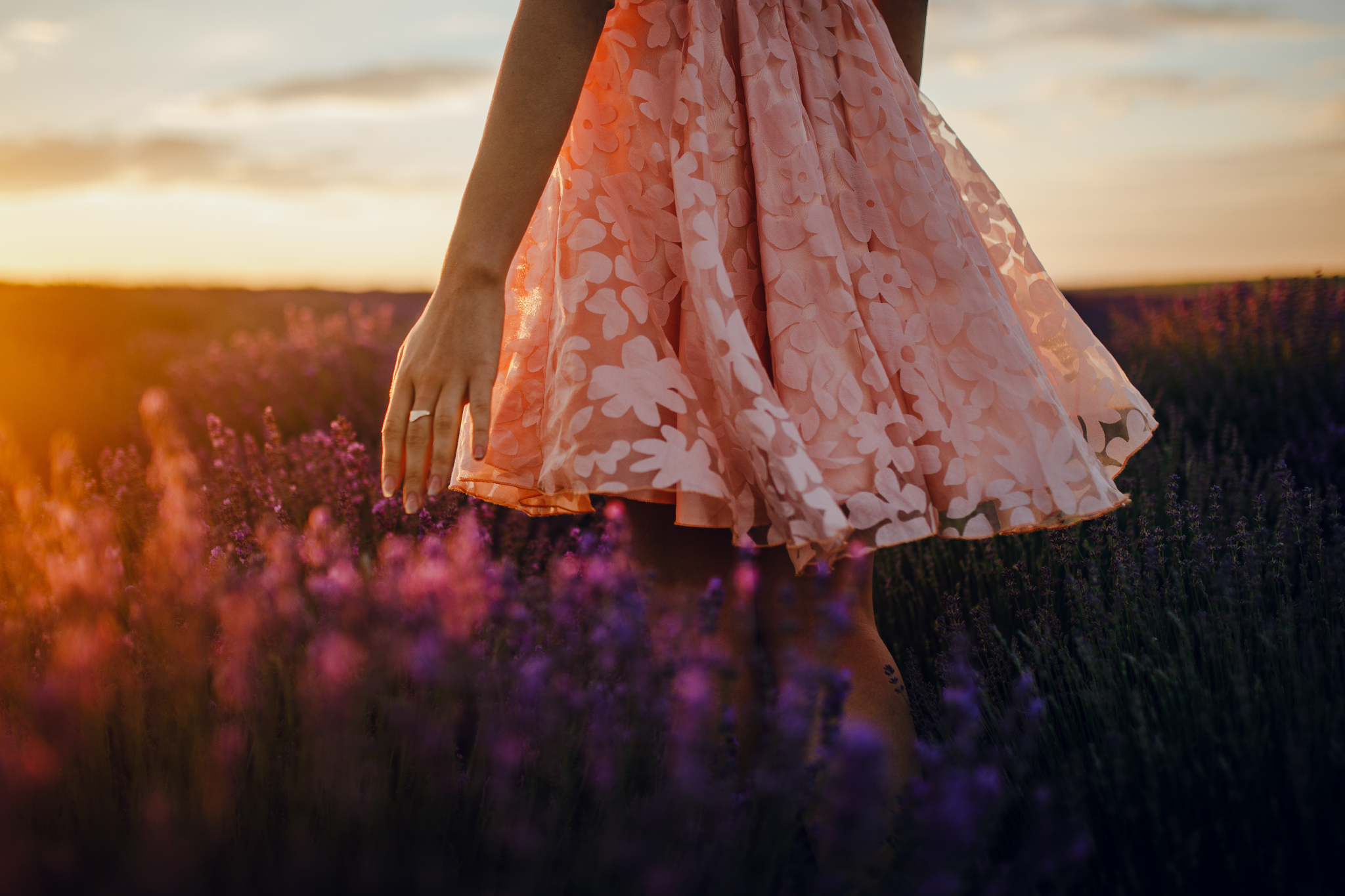 san diego wedding   photographer | bottom half of woman in pink floral dress walking across   lavender fields