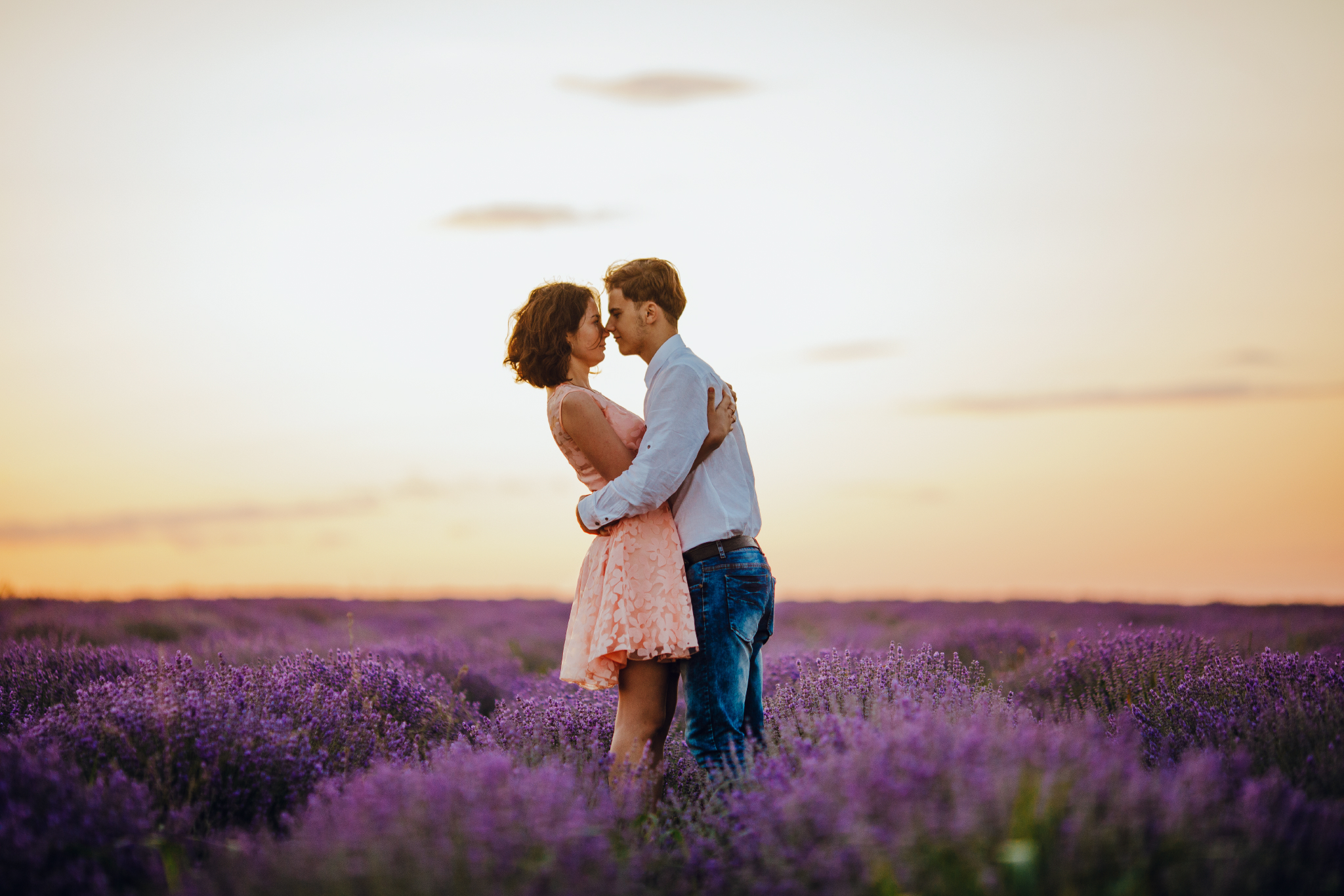 san diego wedding   photographer | whole body shot of couple with faces close to each other and   hugging in lavender fields