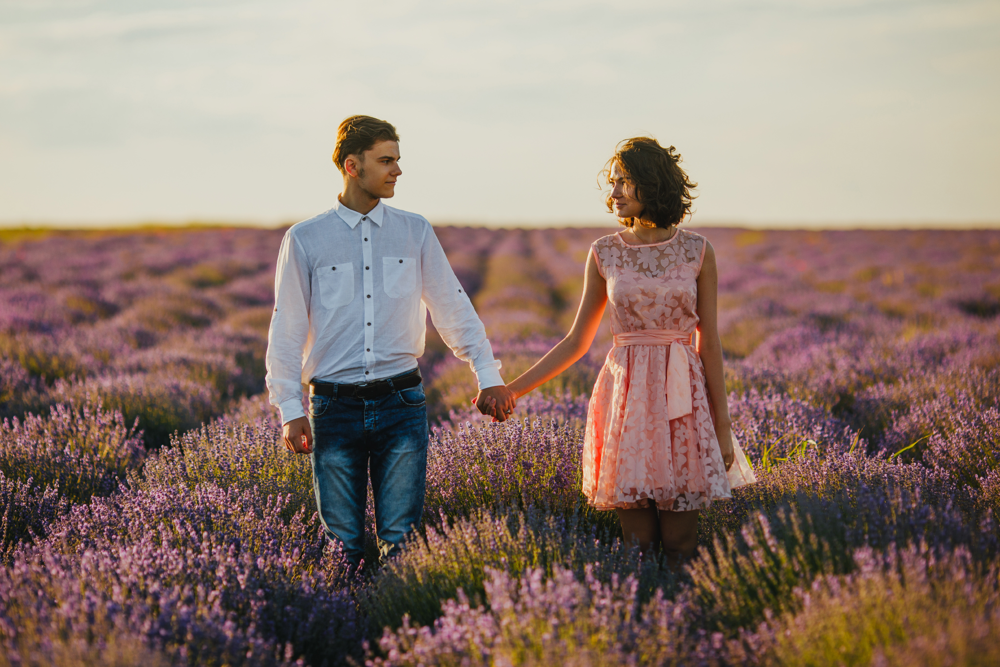 san diego wedding   photographer | couple holding hands and looking at each other in lavender   fields