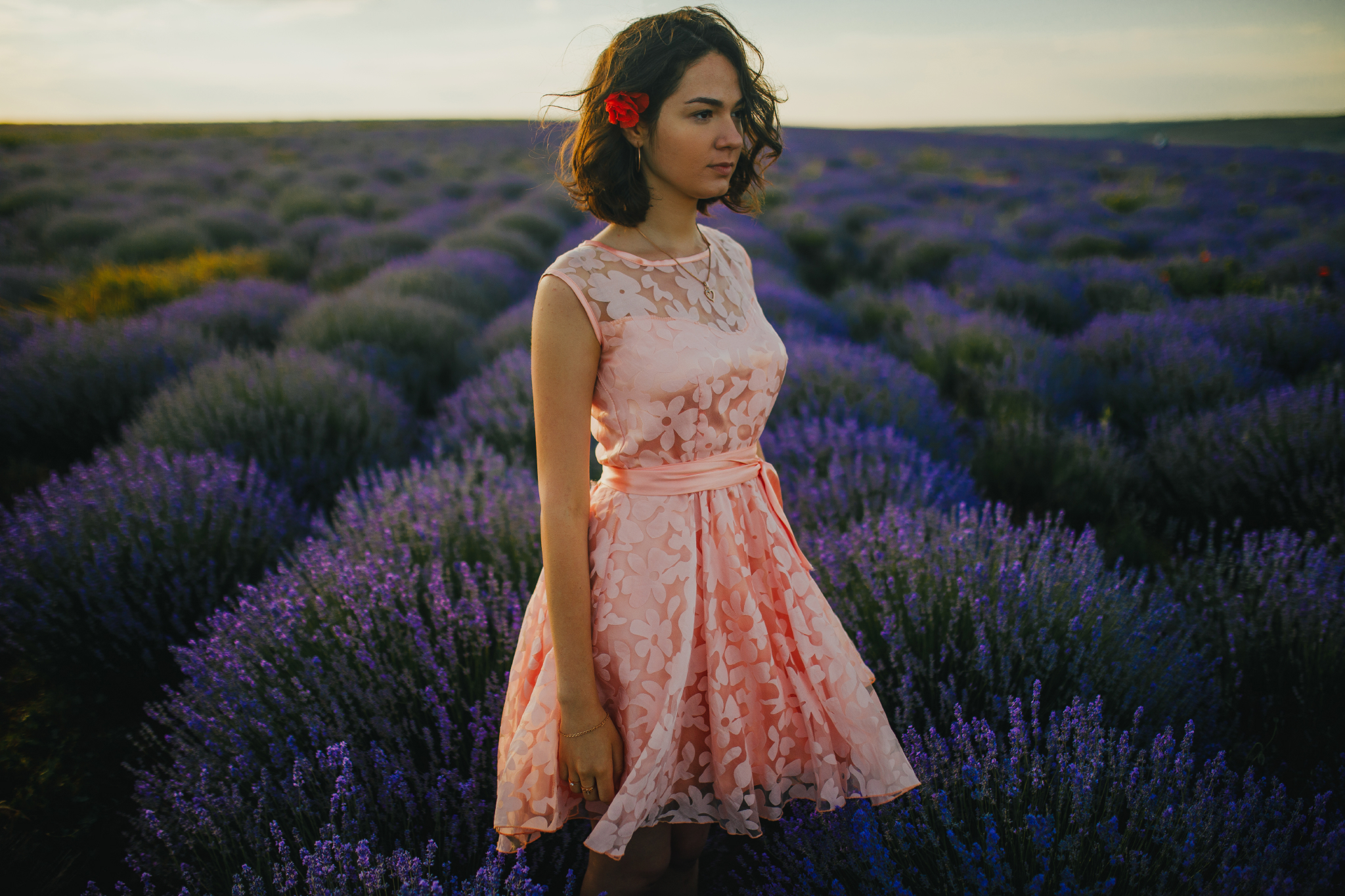san diego wedding   photographer | woman in pink floral dress looking to side in lavender fields