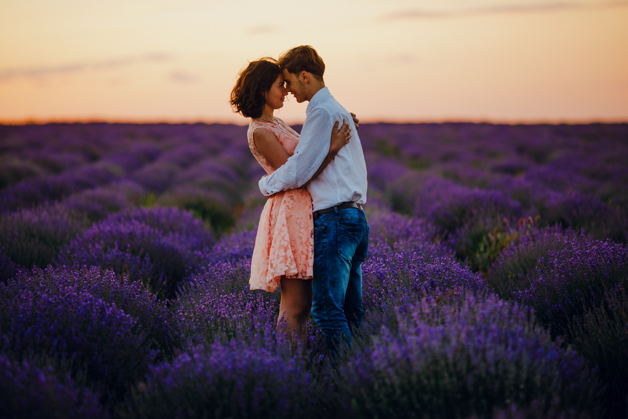 san diego wedding   photographer | woman in pink floral dress hugging blonde man in lavender   fields