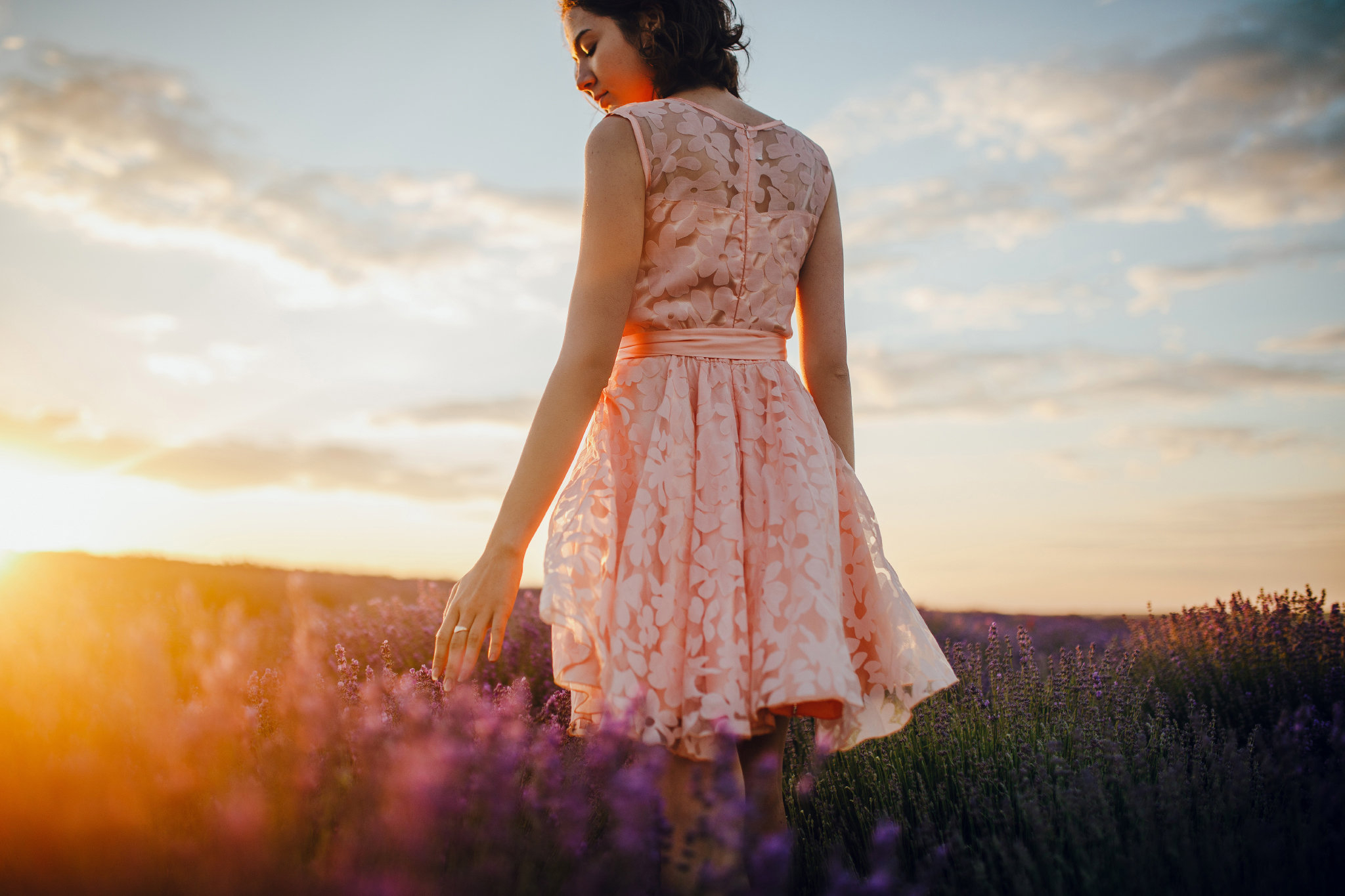 san diego wedding   photographer | woman in pink floral dress walking across lavender fields and   closing eyes