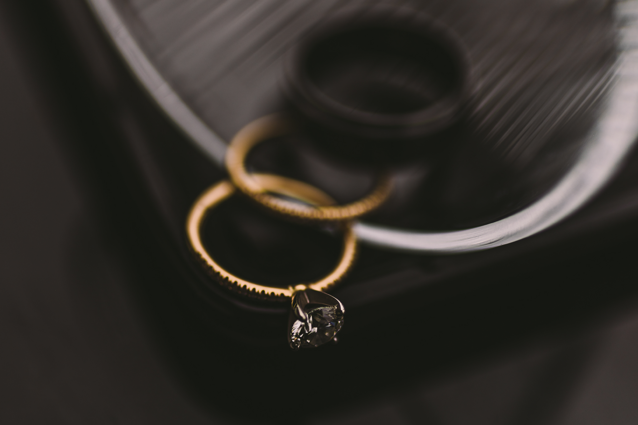 san diego wedding   photographer | picture of two rings on and edge of a table