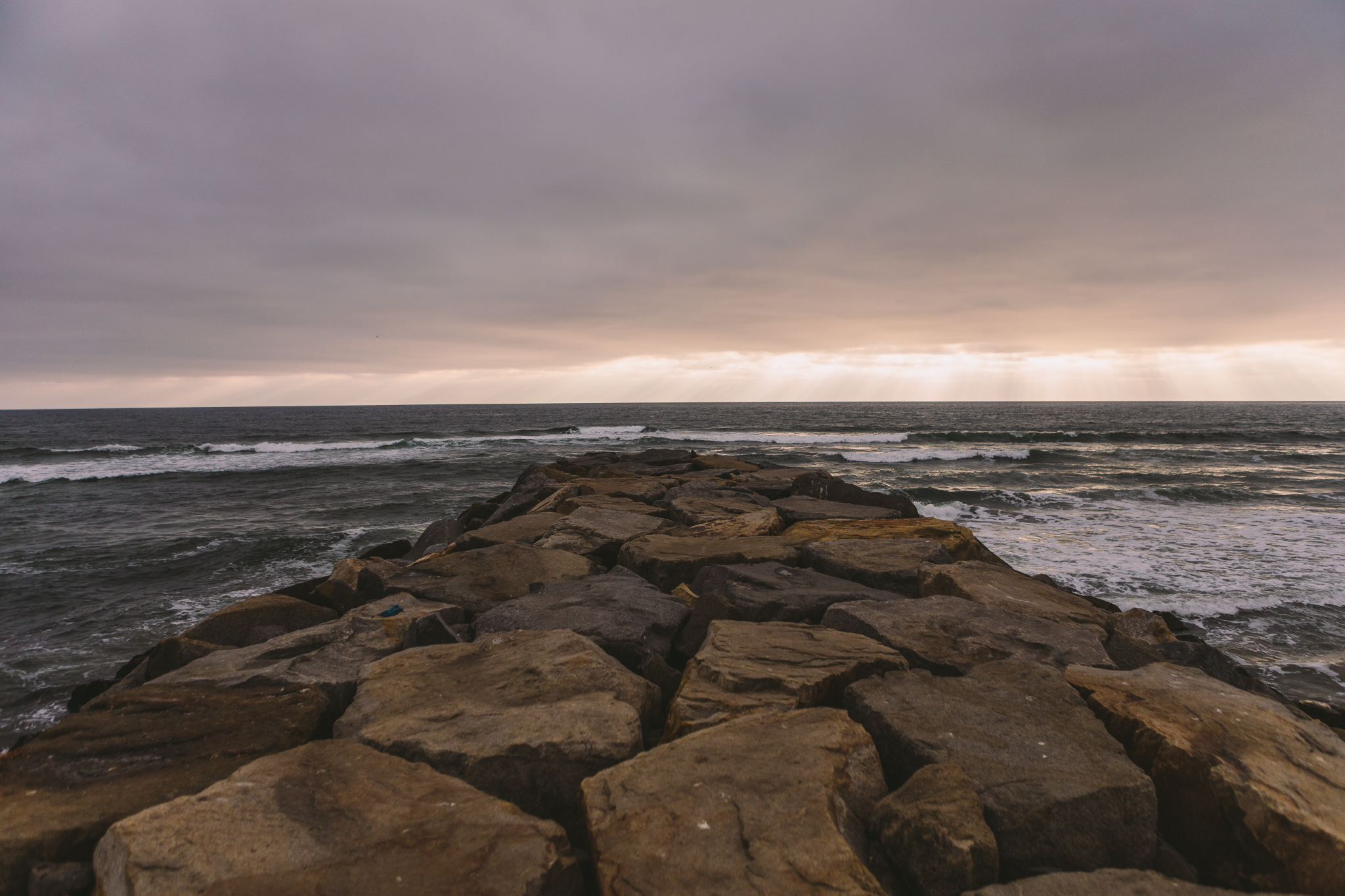 san diego wedding   photographer | rocky shore with sunset in the distant background