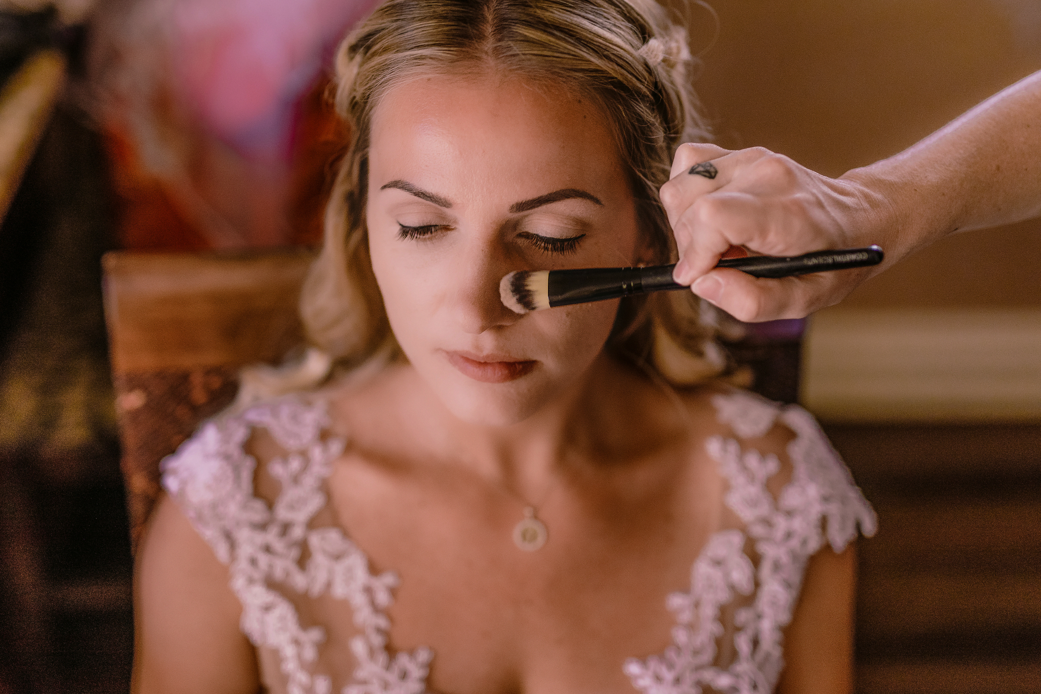 san diego wedding   photographer | woman in white dress with a makeup brush on her face