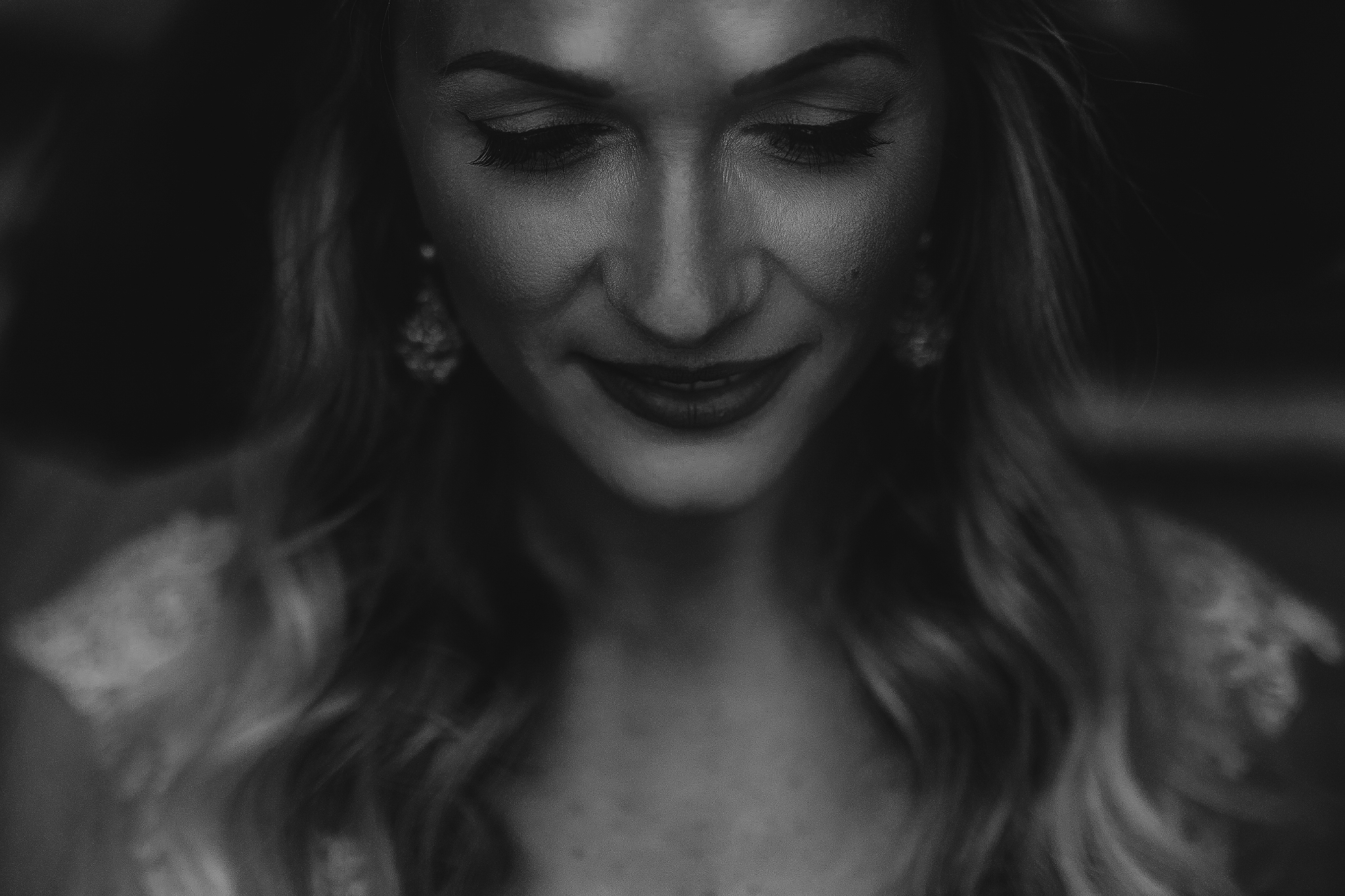 san diego wedding   photographer | black and white shot of woman in white dress smiling looking   down in front of her