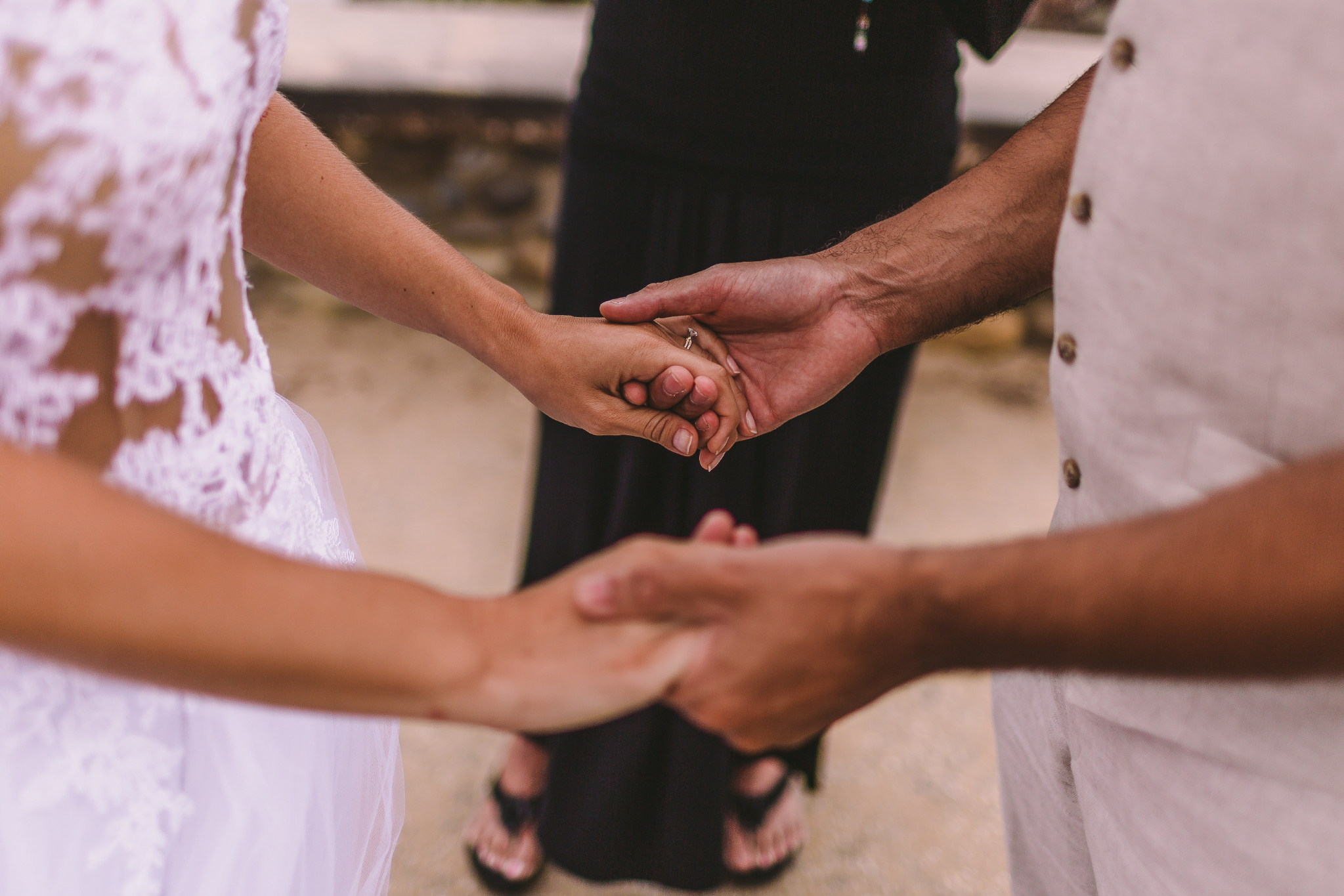 san diego wedding   photographer | bride and groom holding hands while standing in front of   wedding officiator