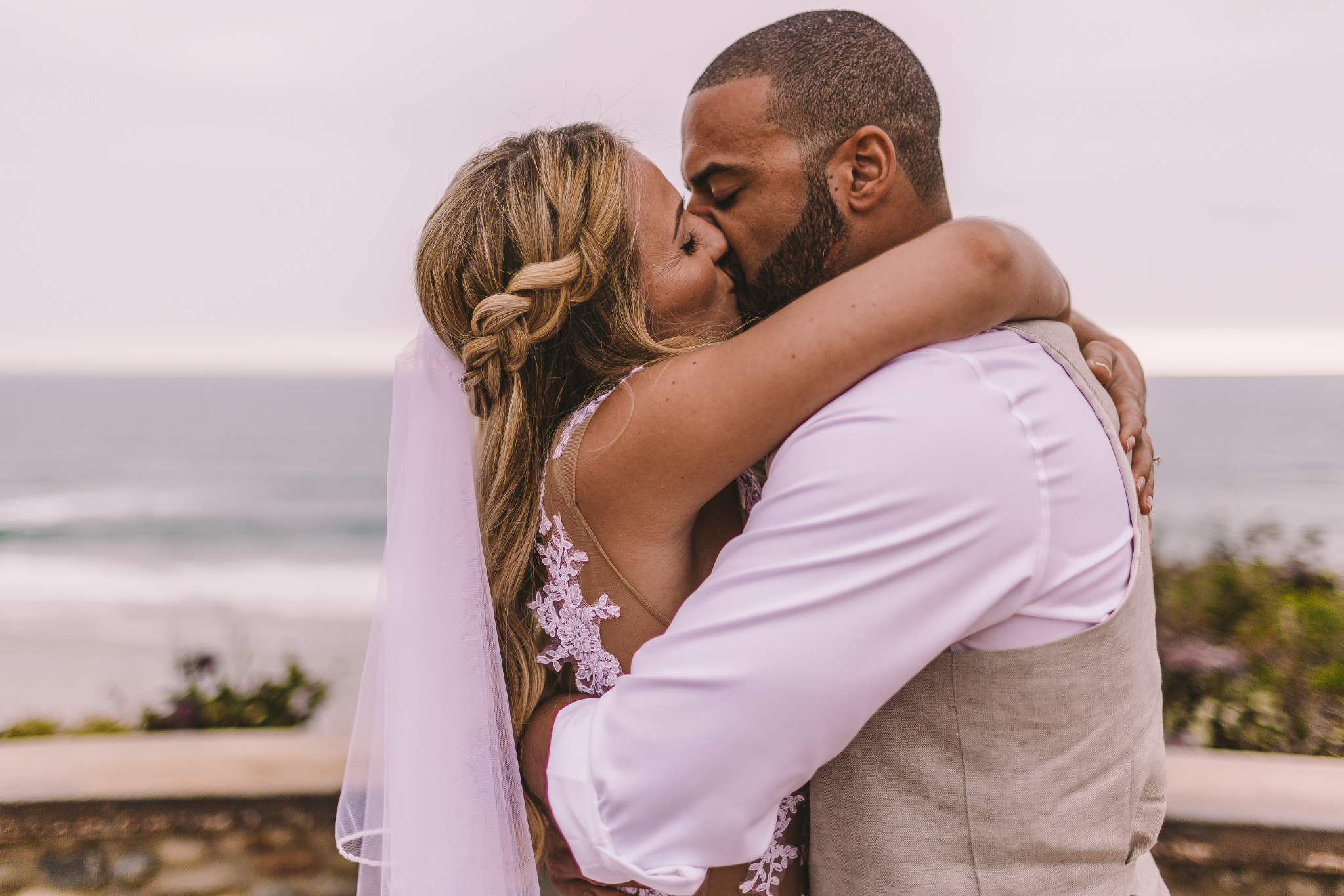 san diego wedding   photographer | married couple kissing each other with bride's arms around   groom's back and neck