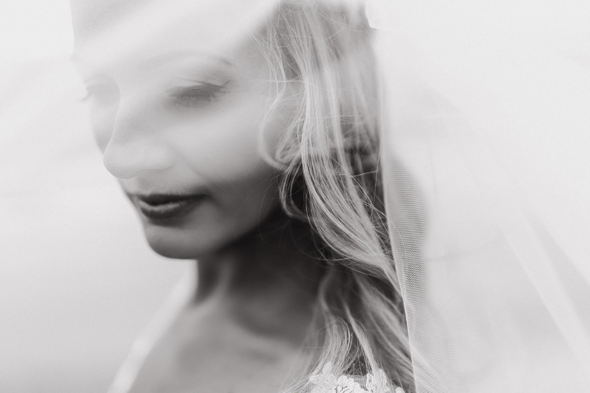 san diego wedding   photographer | black and white shot of woman in white dress seen through a   thin veil