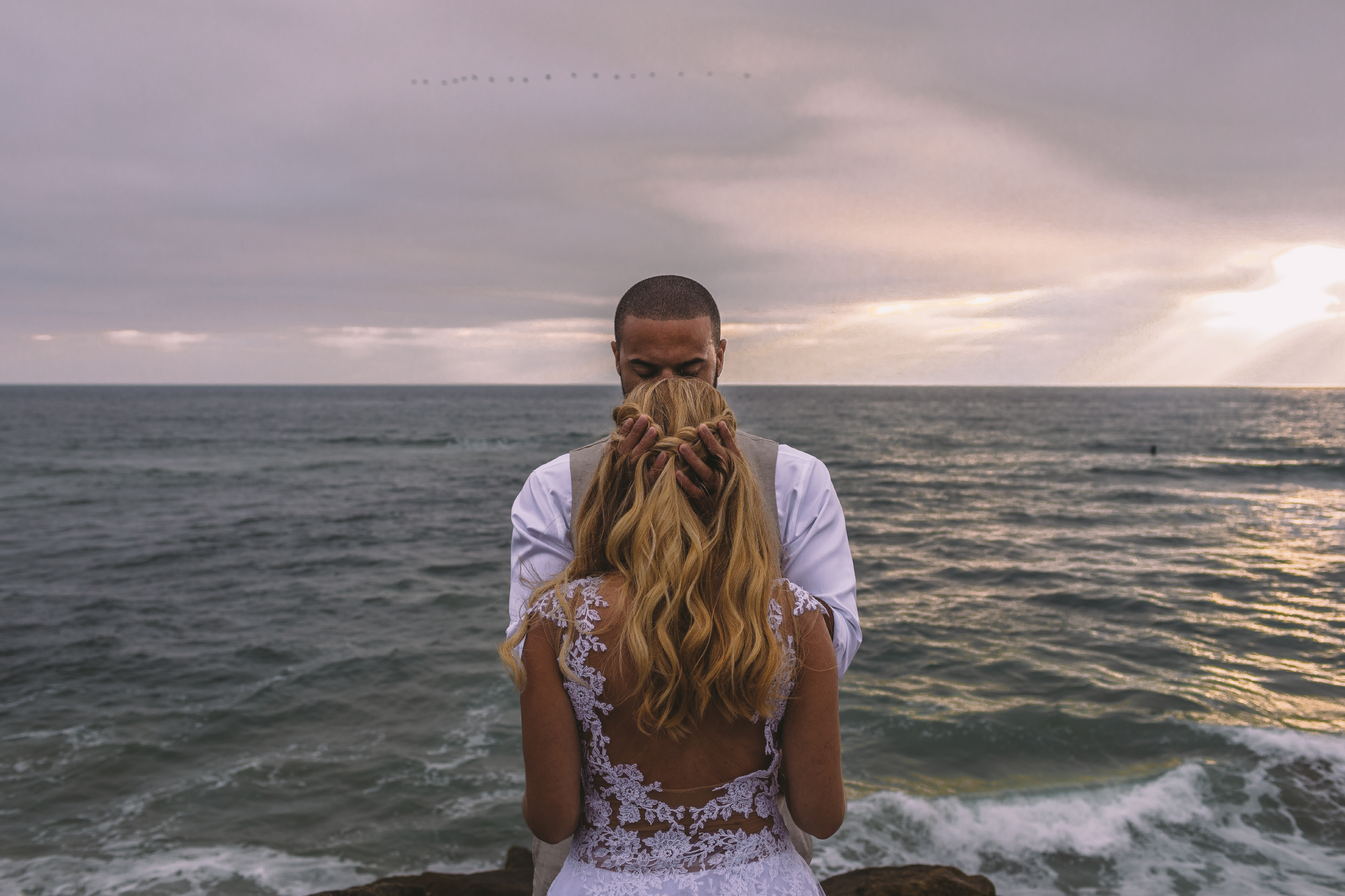 san diego wedding   photographer | woman from behind covering man in front of her with the sea in   the background