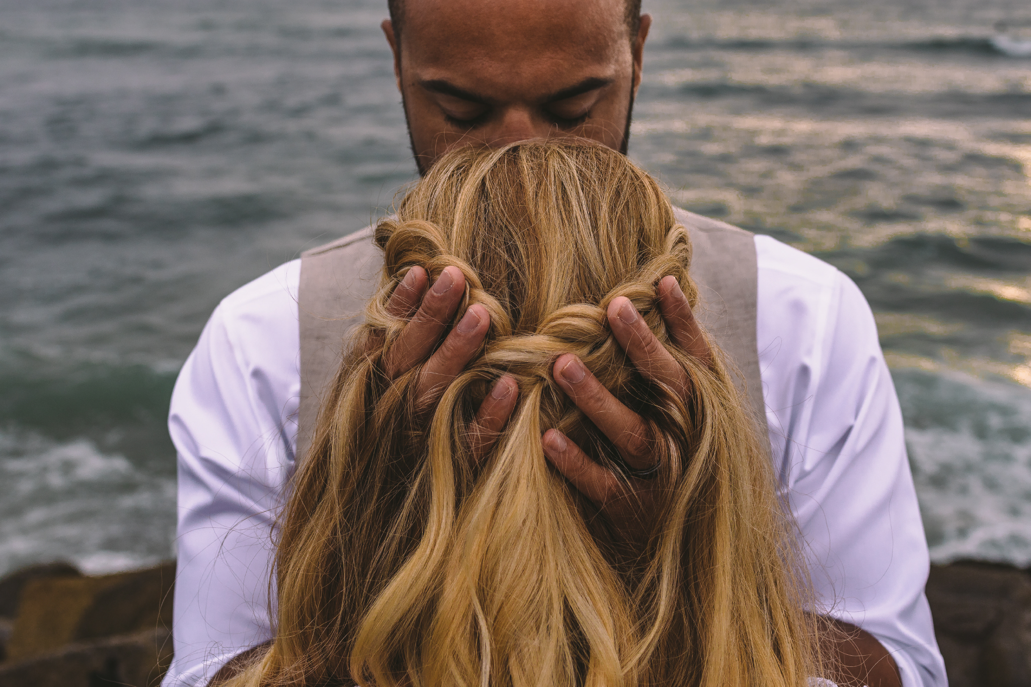 san diego wedding   photographer | woman from behind covering man in front of her with man's   hands in woman's hair