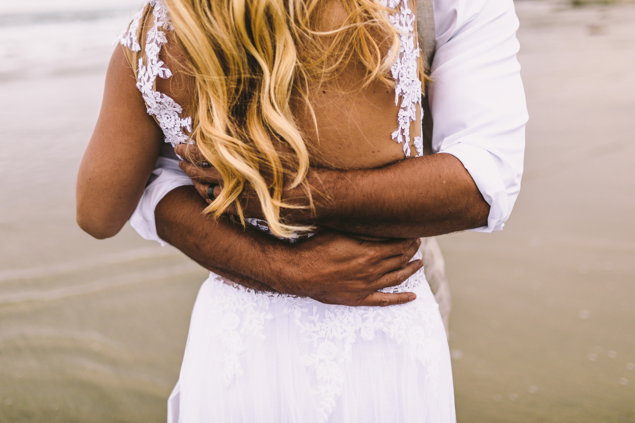 san diego wedding   photographer | torso of bride's back with groom hugging her from her front
