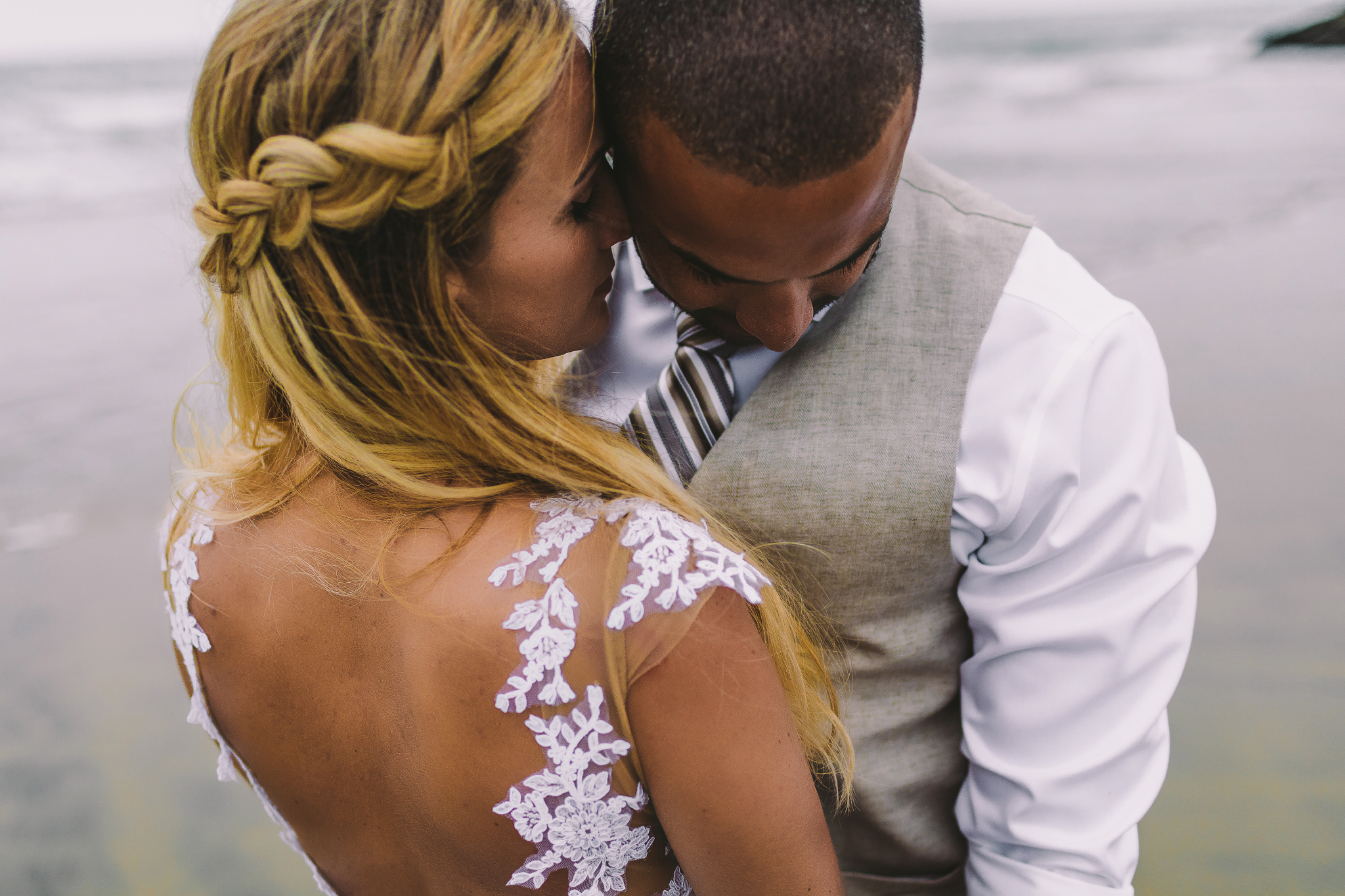 san diego wedding   photographer | bride whispering something into groom's ear while groom looks   down