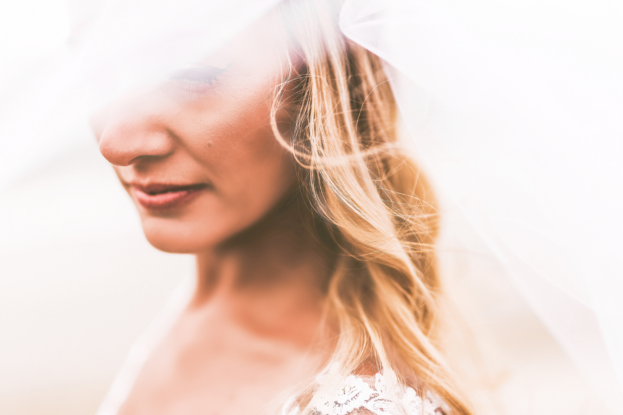 san diego wedding   photographer | woman in white dress partially covered with a thin veil